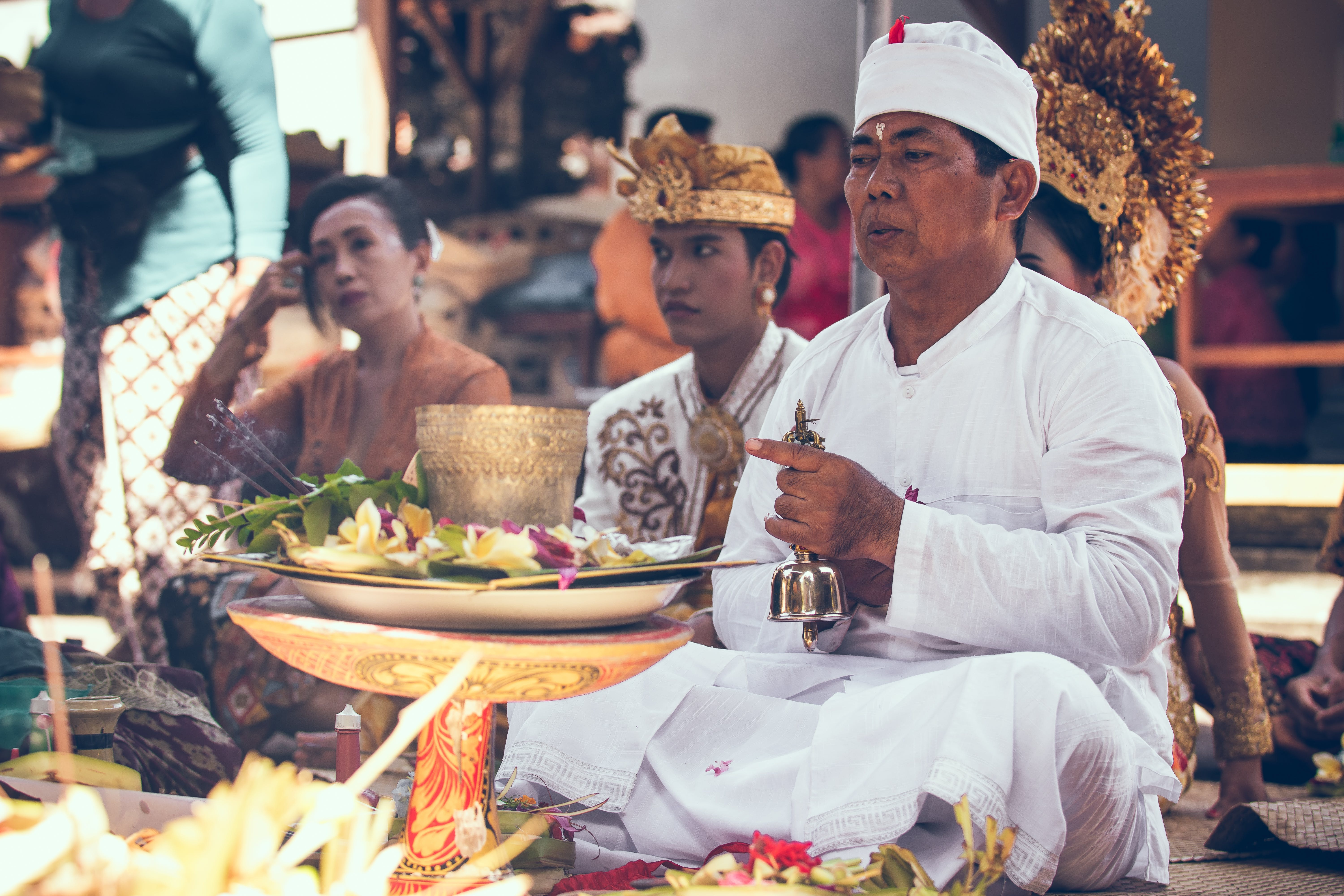 Man Sitting in Front of Woman Near Table Performing Ritual Ceremony