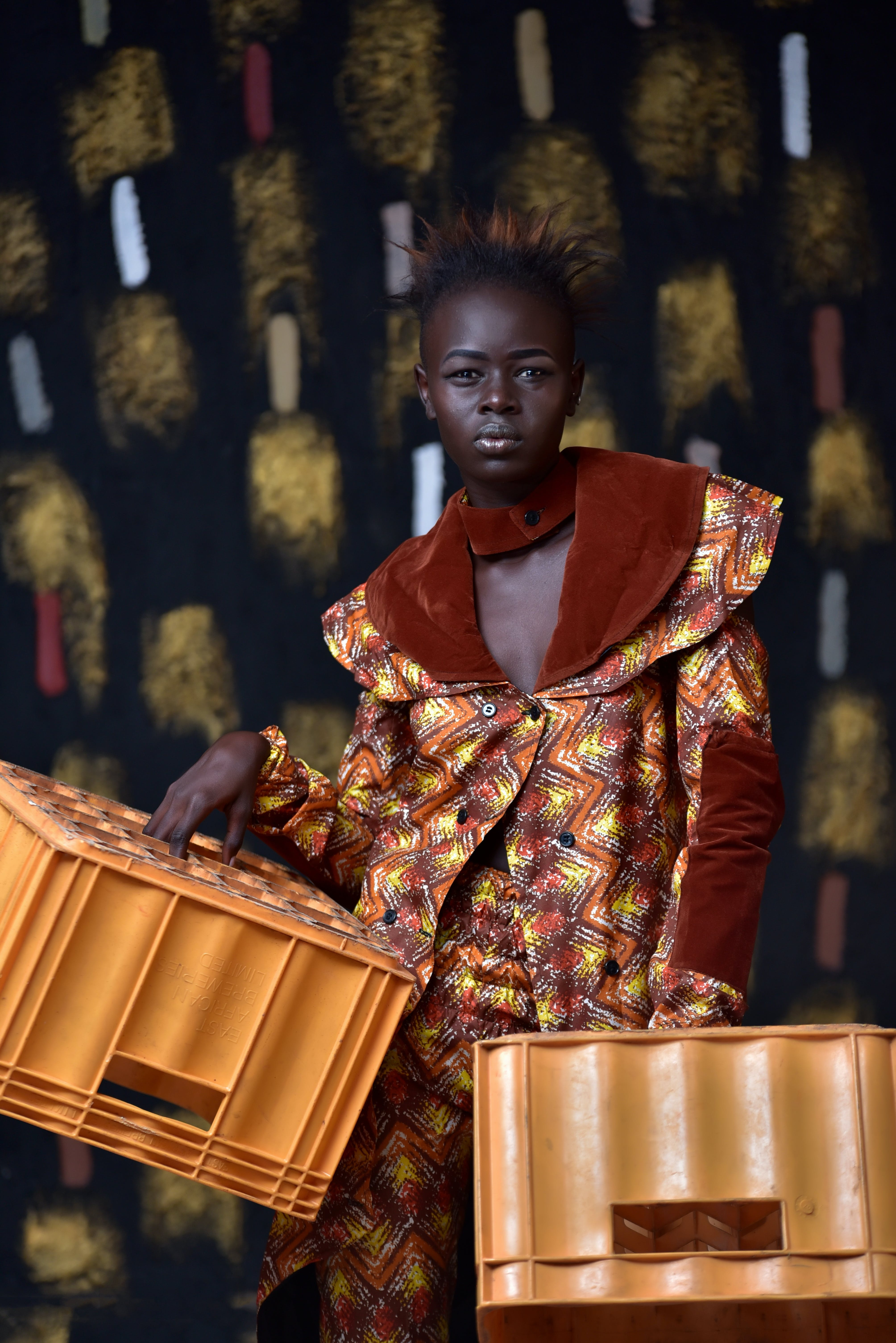 Woman Carrying Two Plastic Crates
