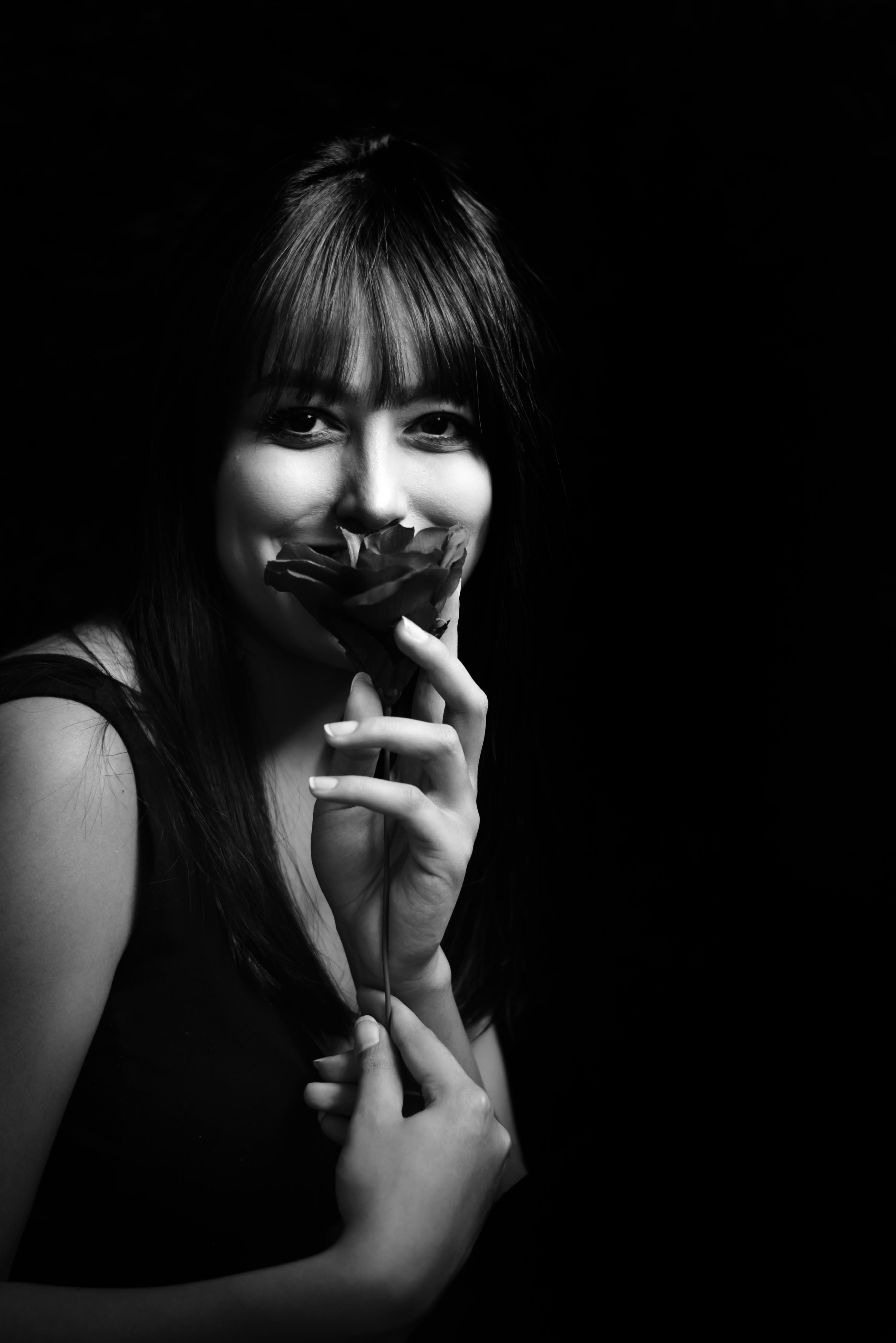 Grayscale Photo of Woman Holding Flower