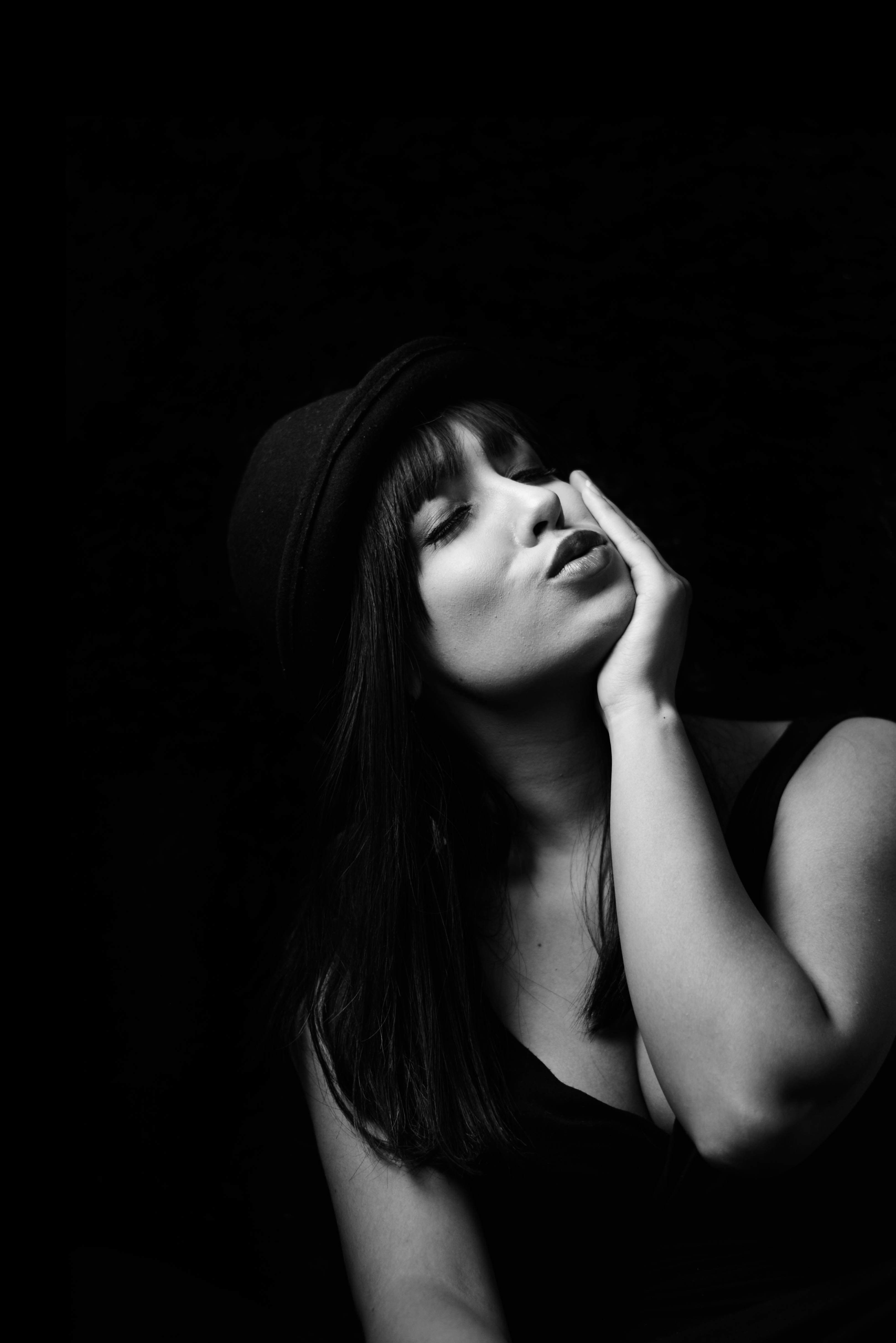 Grayscale Photography Of Woman In Tank Top Wearing Hat