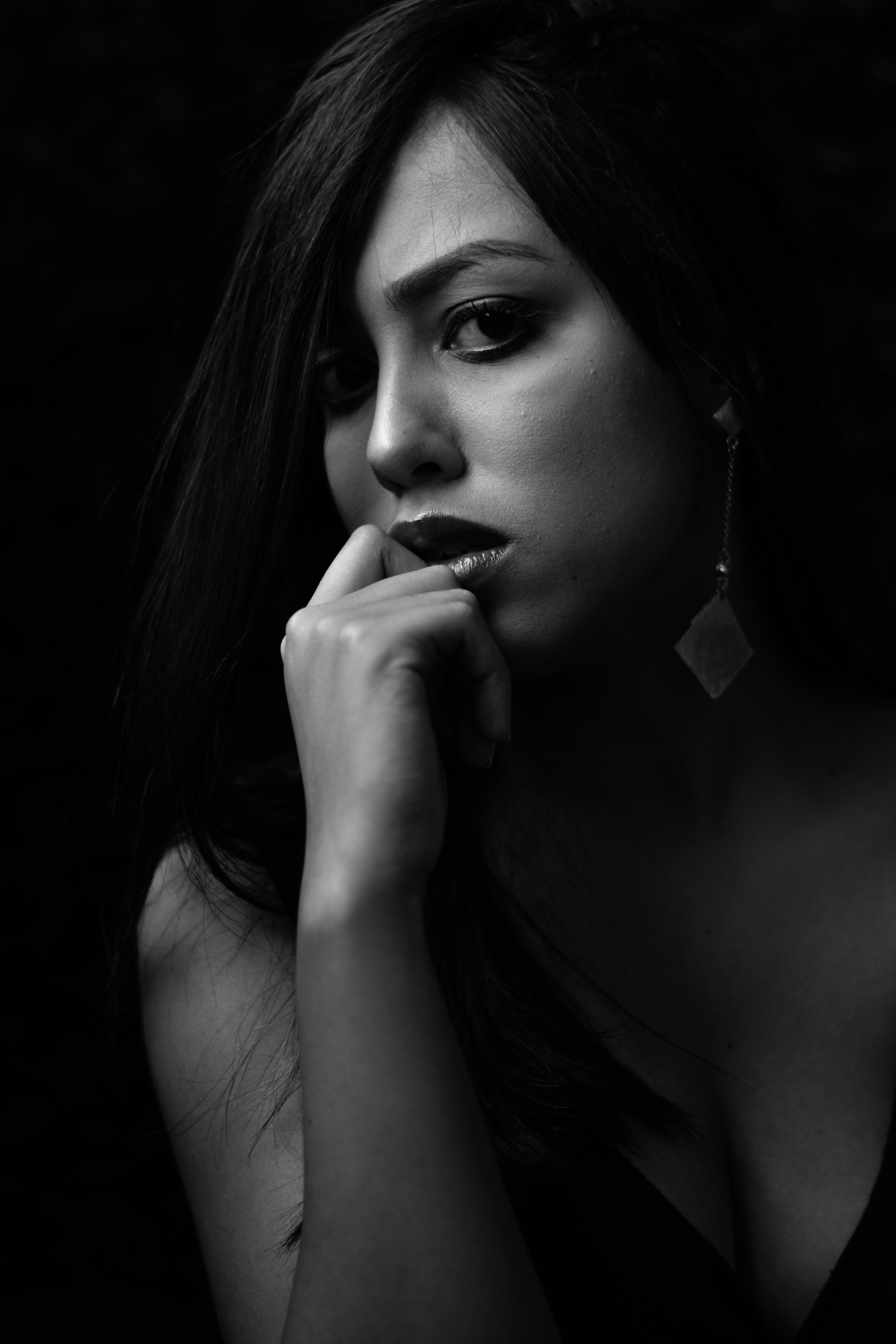 Grayscale Photo of Woman in Black Plunging Neckline Top