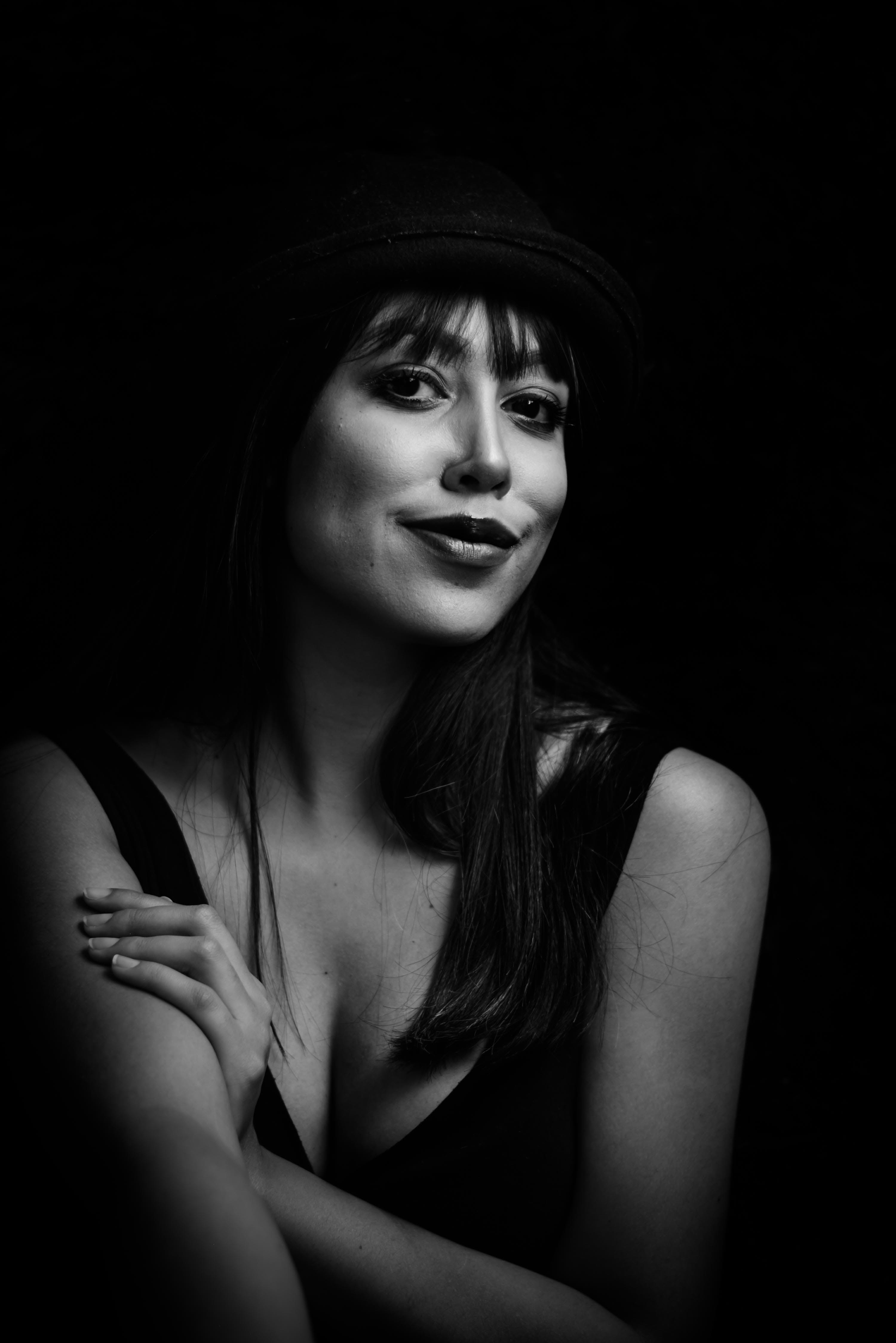 Greyscale Photo of Woman Wearing Tank Top and Hat