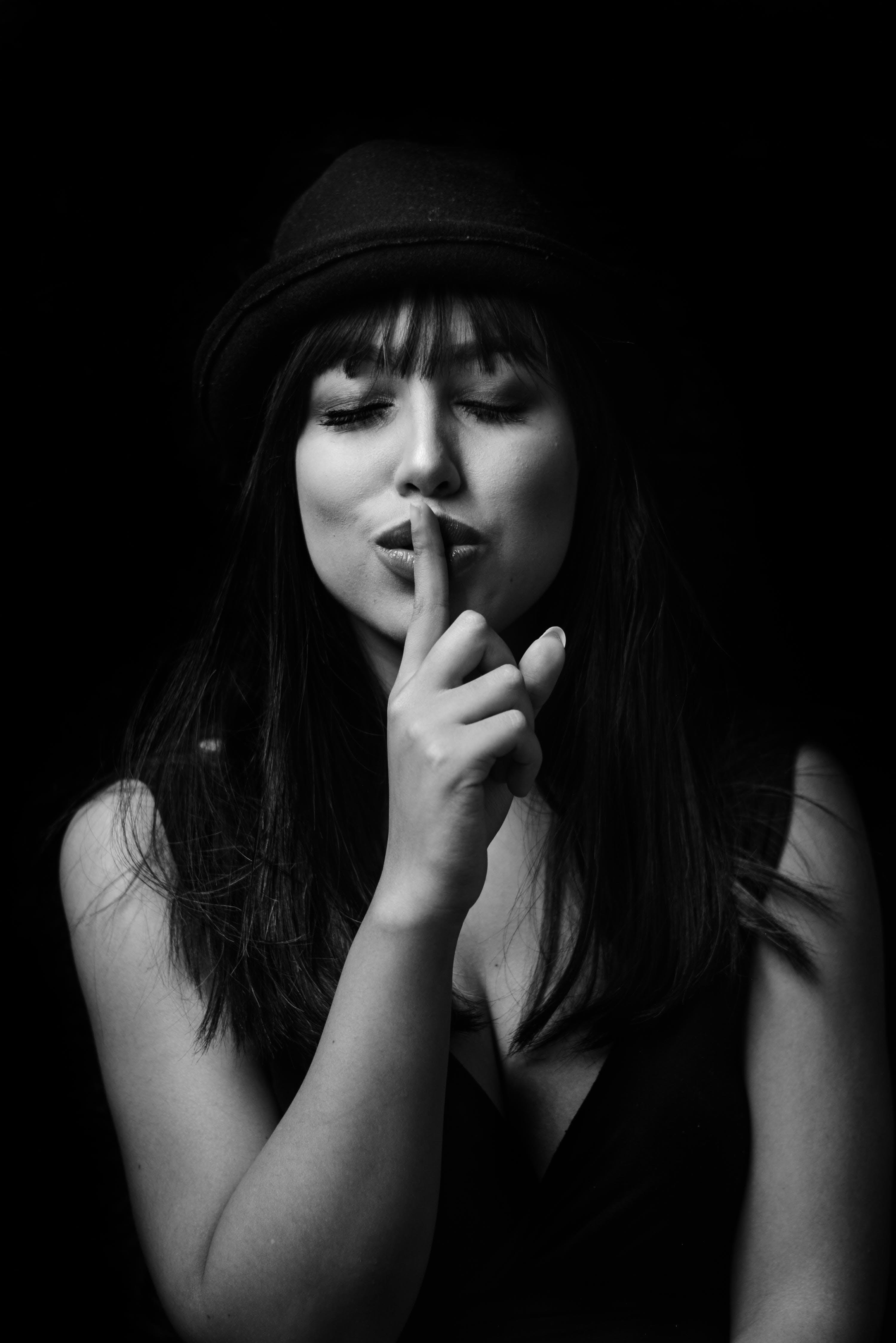 Monochrome Photography of Woman Doing Silent Gesture