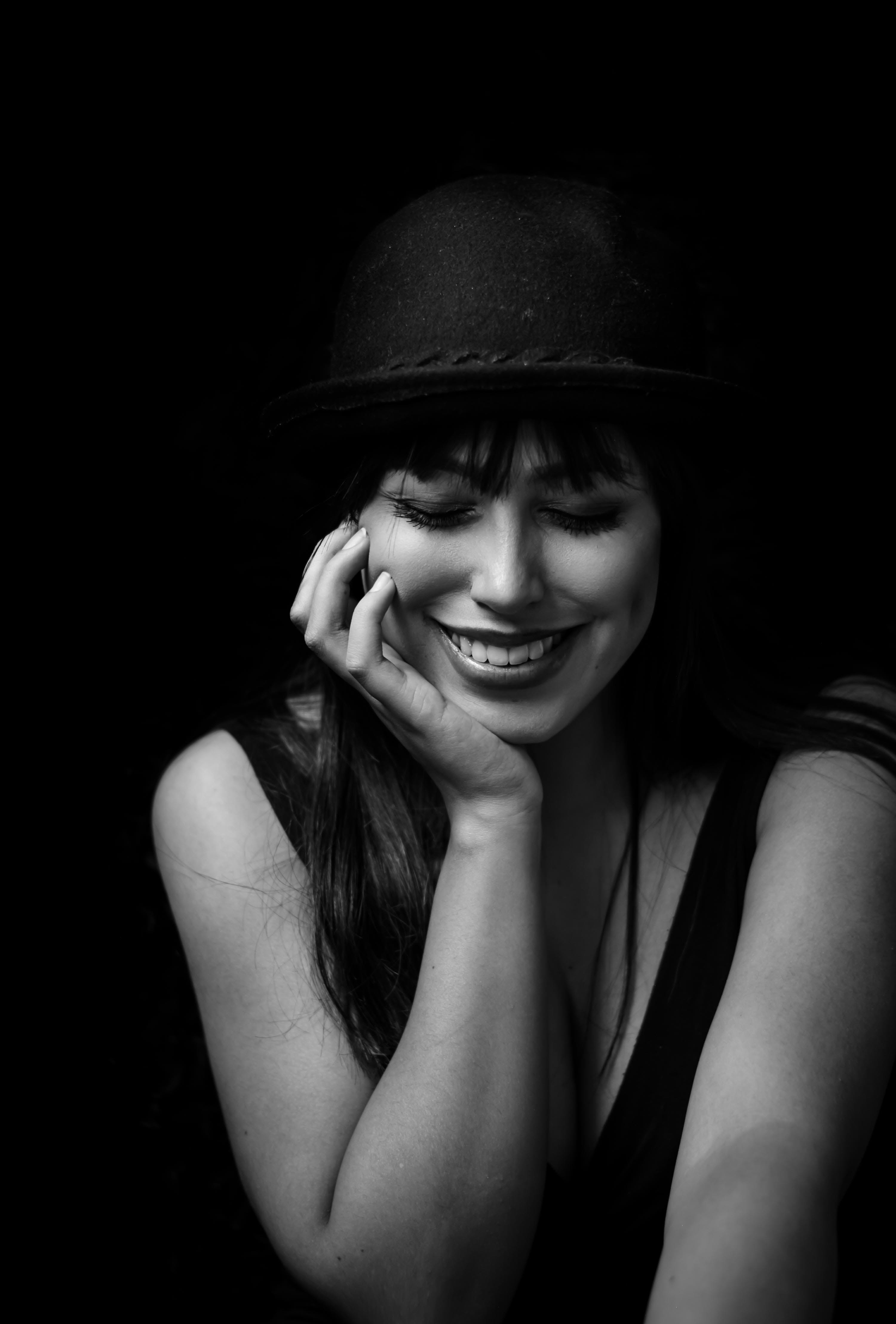 Grayscale Photography of Smiling Woman Putting Hands on Face