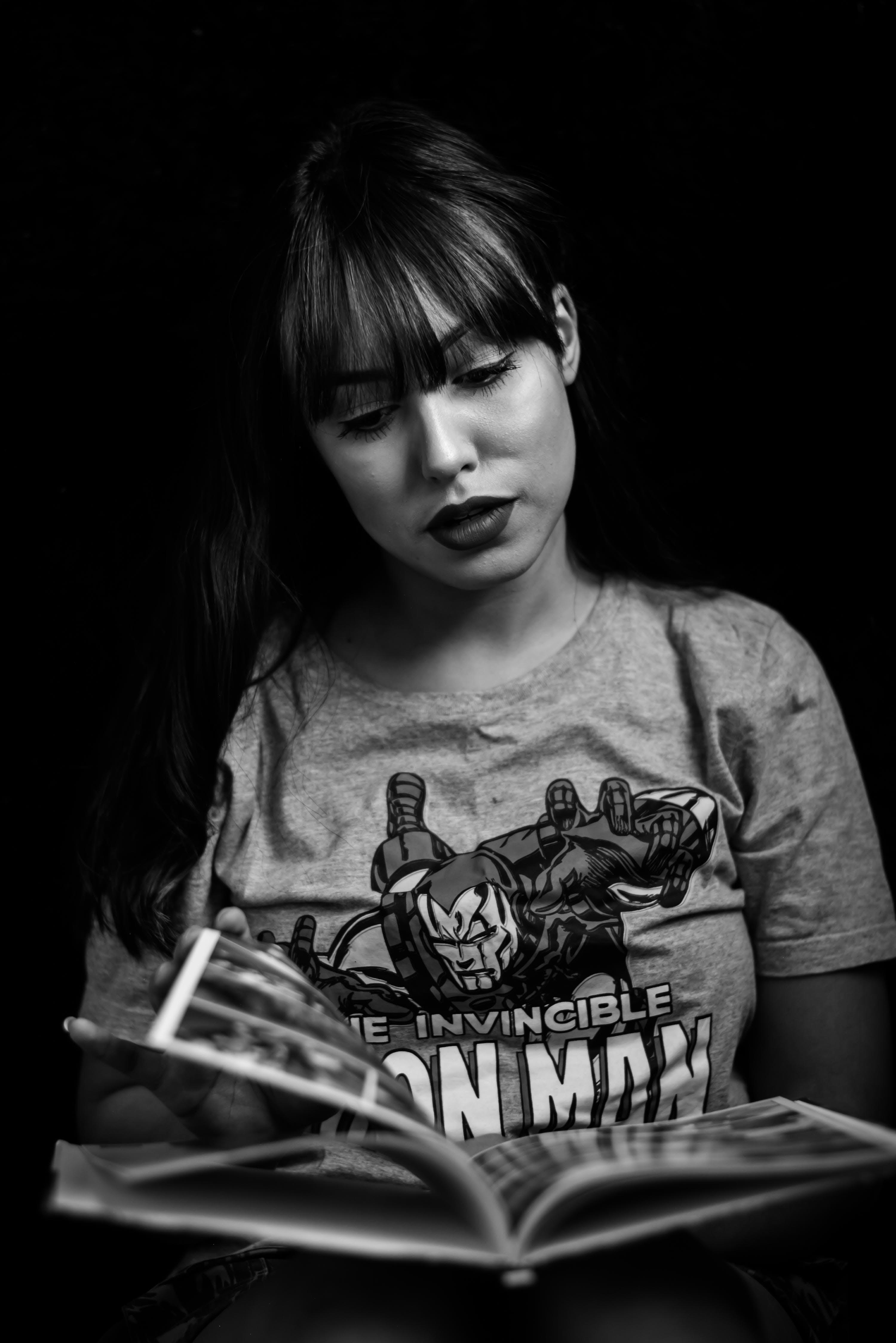 Monochrome Photography of Woman Reading Magazine