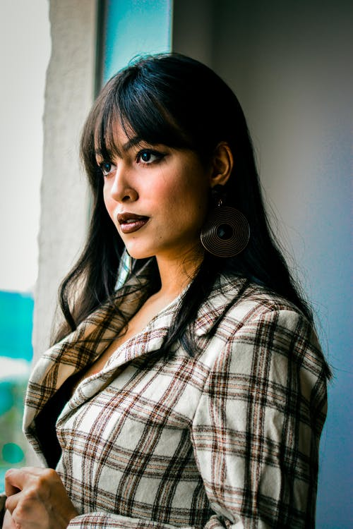 Woman Wearing Gray and Brown Plaid Dress Shirt