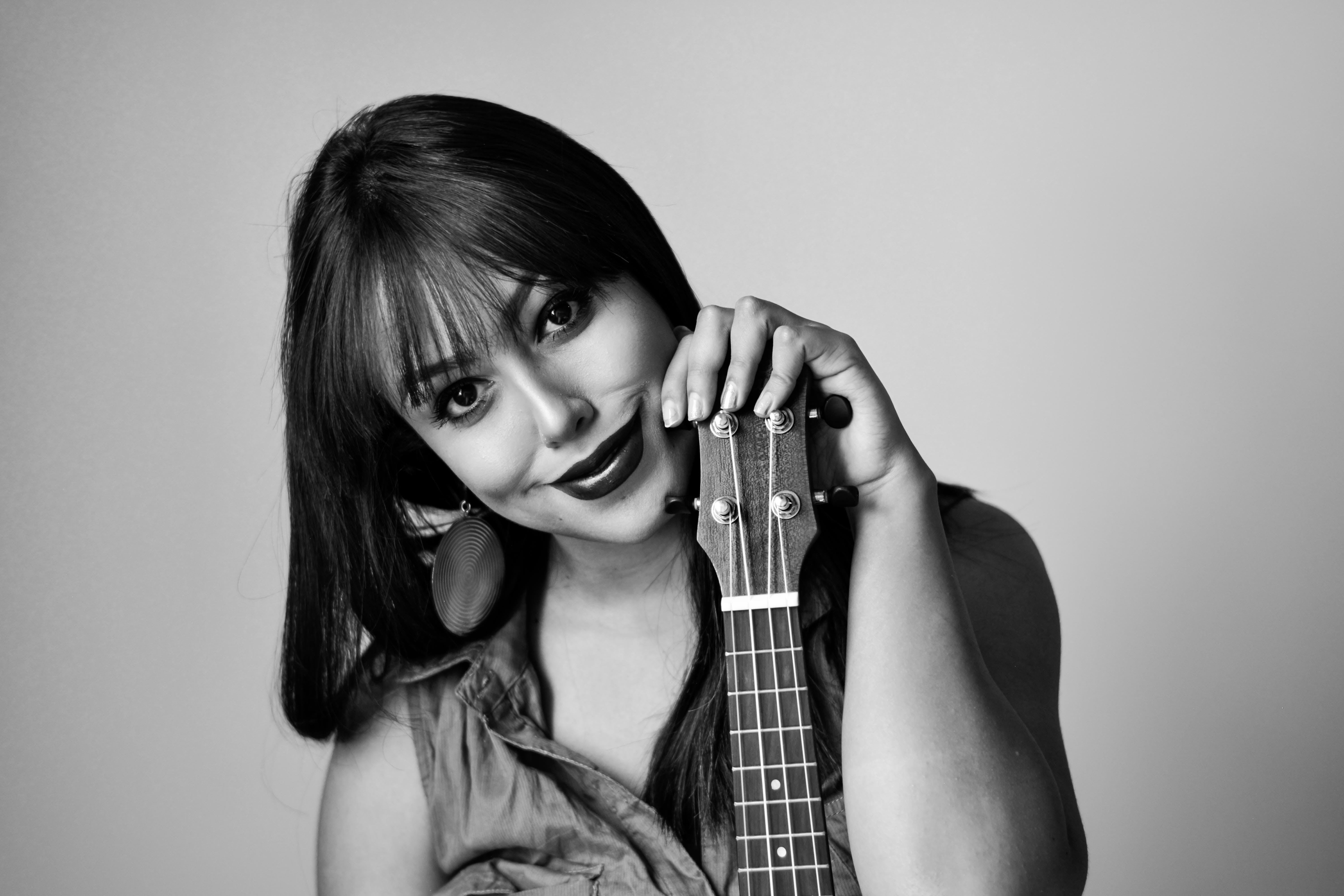 Photography of a Woman Holding Ukelele
