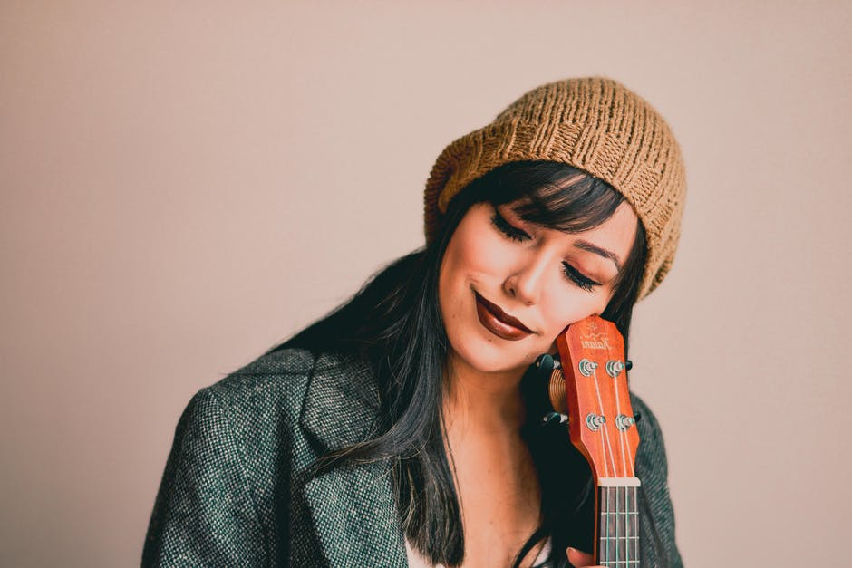 Photography of a woman holding ukelele