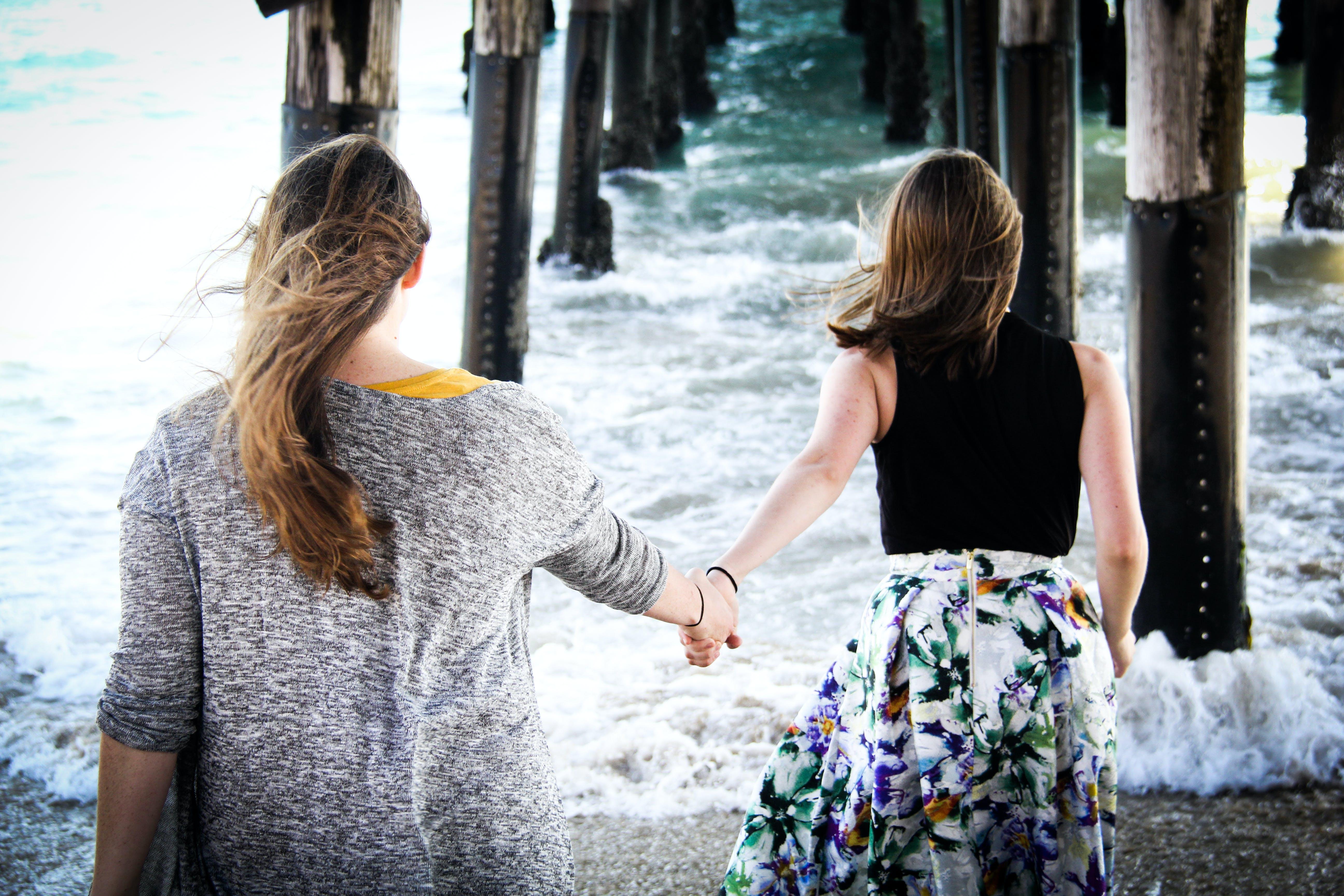 Photography of Women On Seashore