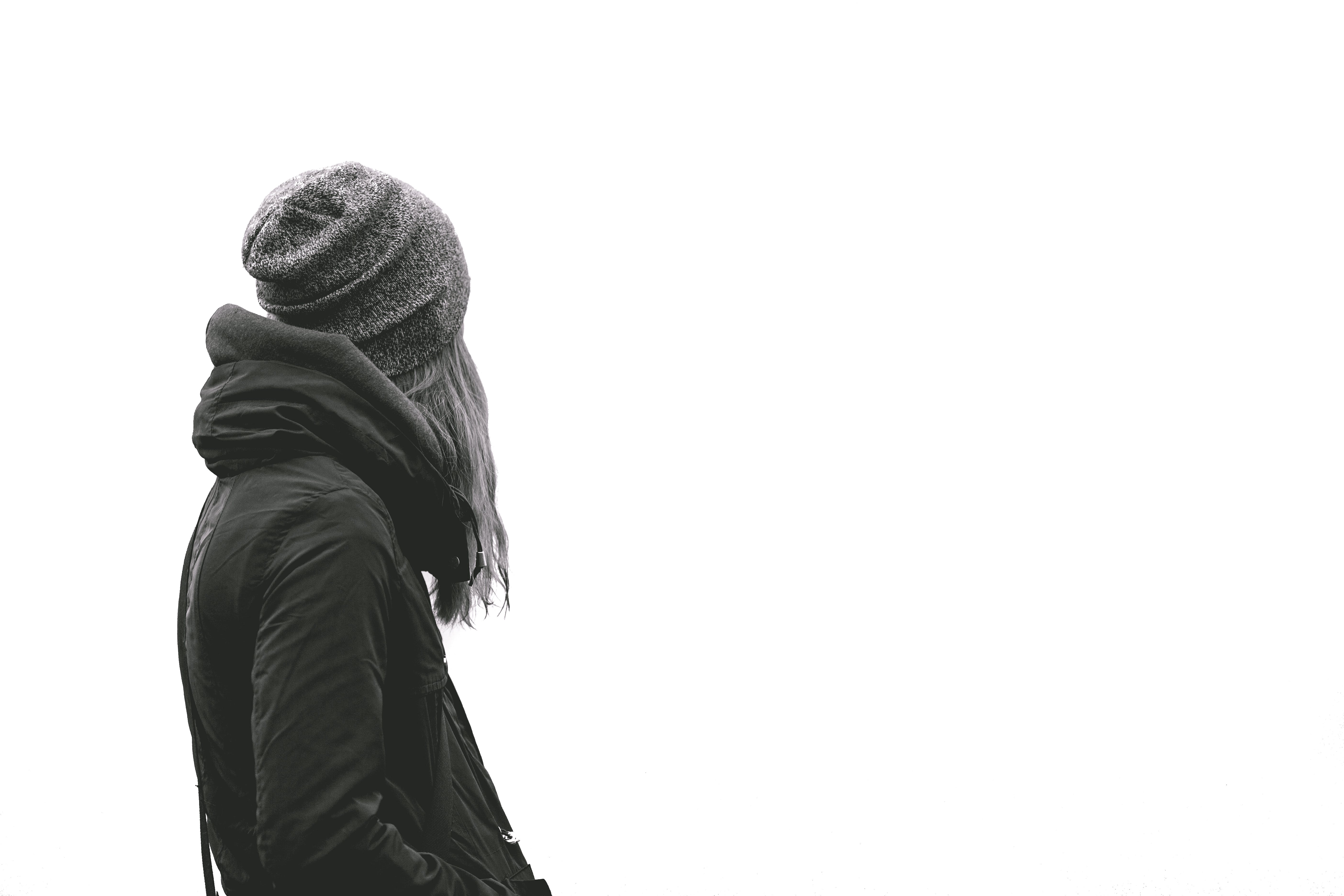 Woman Wearing Black Hoodie and Knit Cap