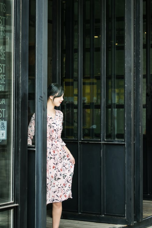 Black Haired Woman in Pink and Black Floral Dress