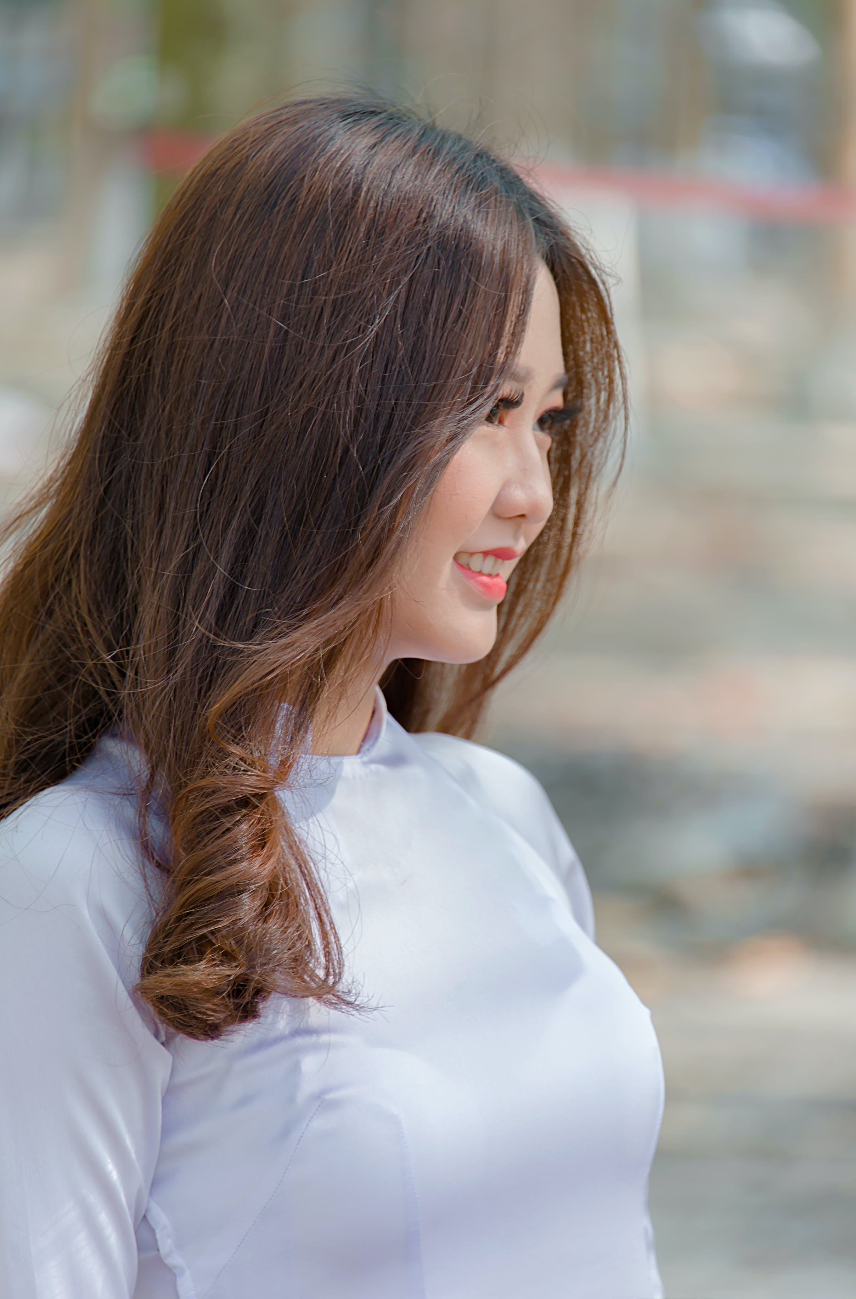 Side View Photo of Woman Wearing White top