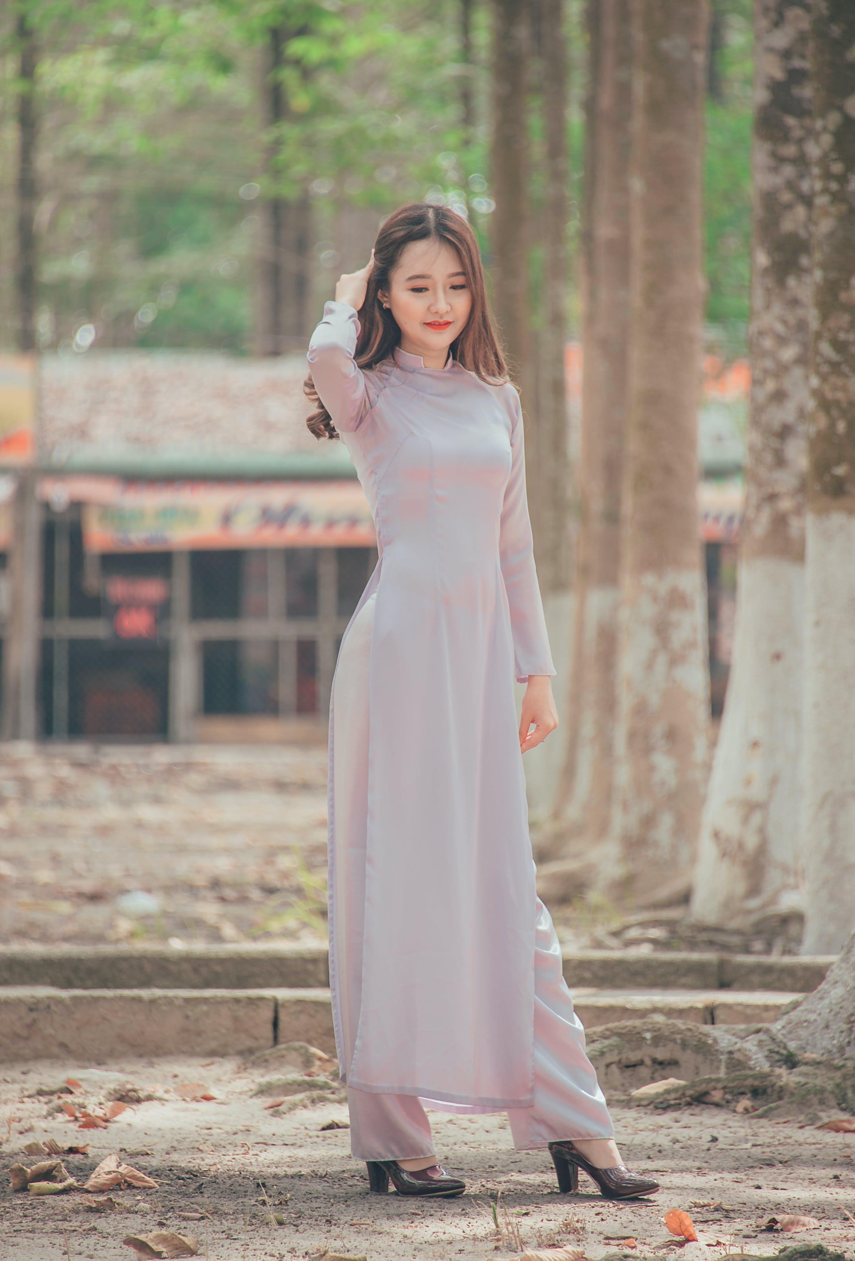 Photo of Woman Wearing Long Dress