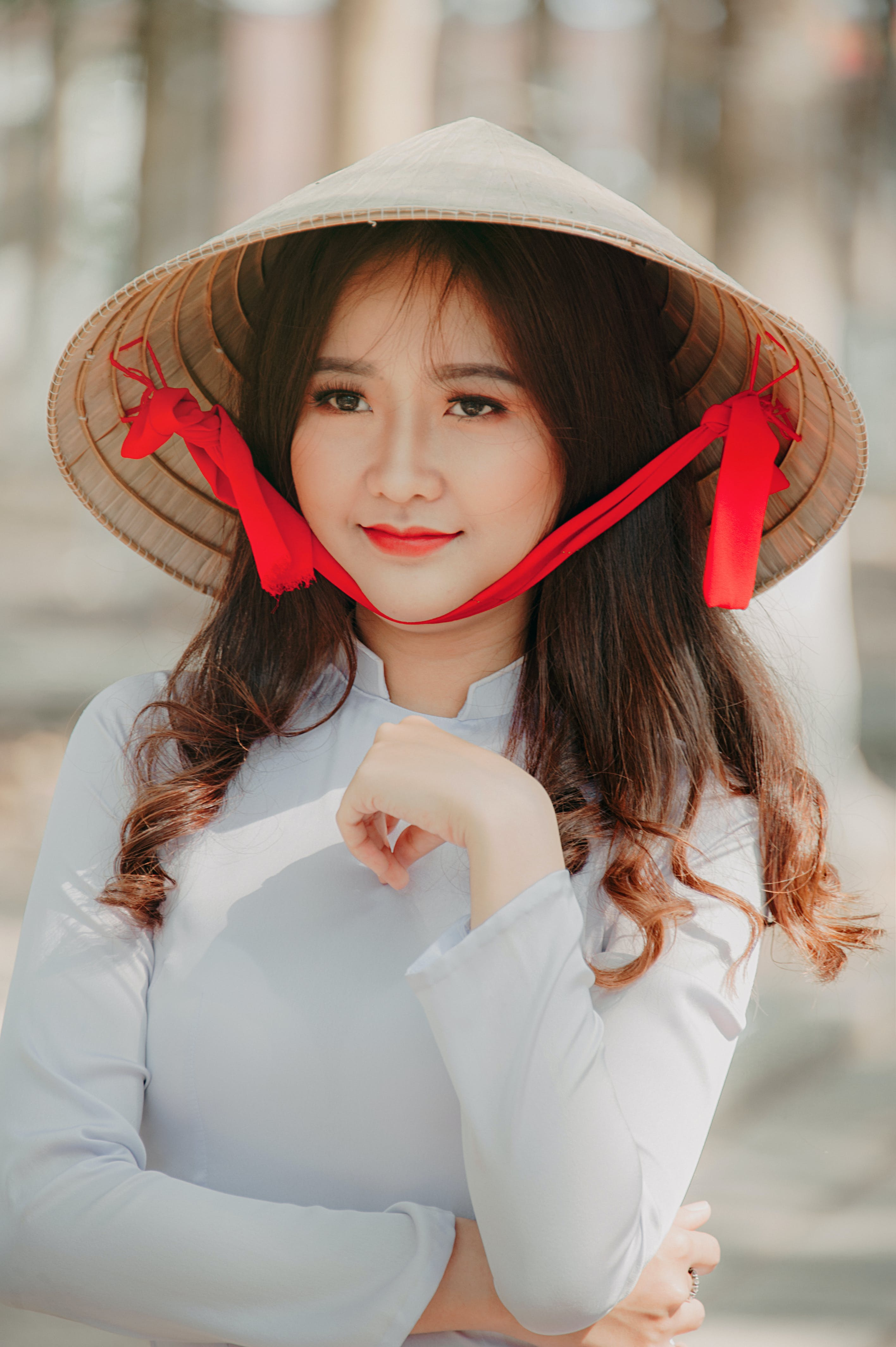 Photography of a Woman Wearing Asian conical hat