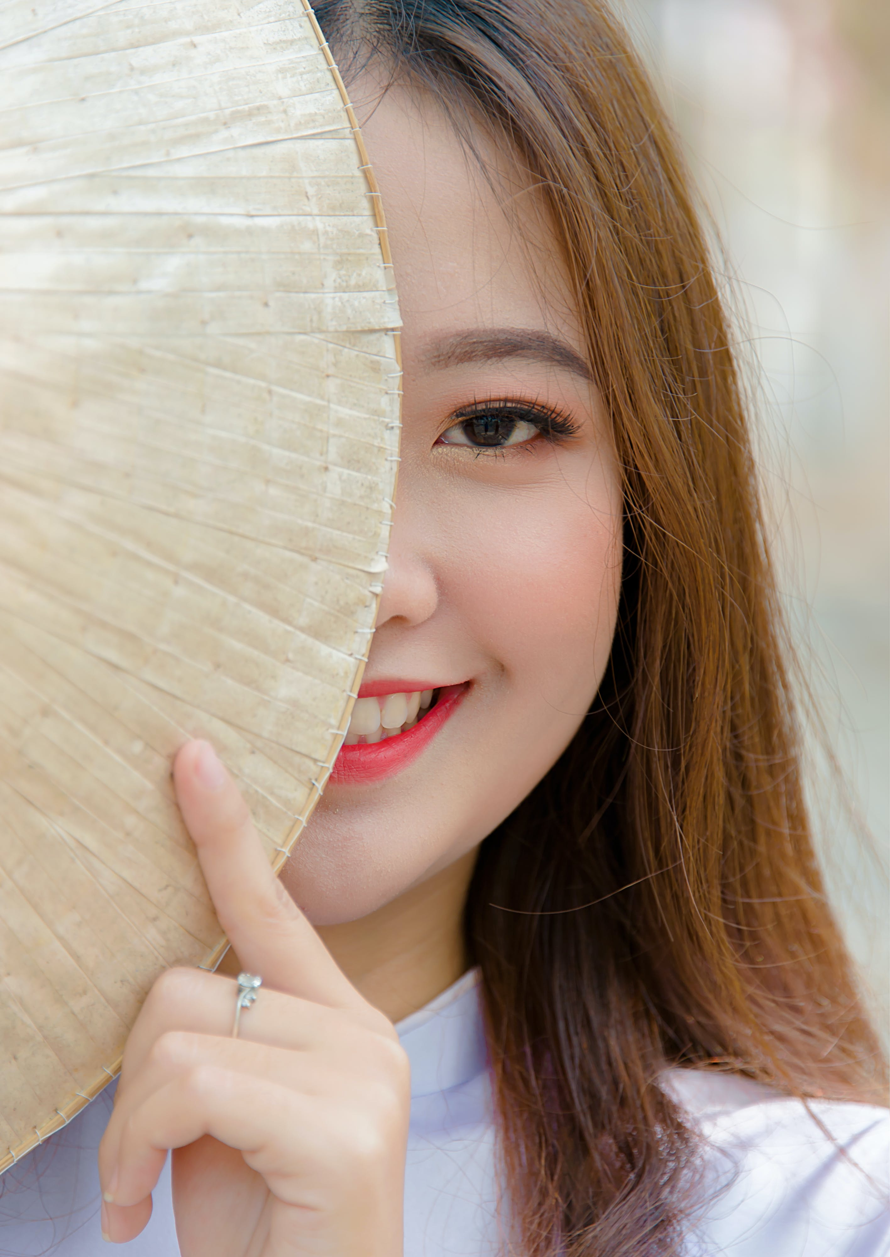 Photo Woman Hiding on Asian Conical Hat
