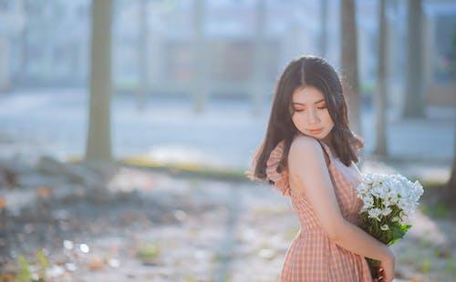 Photo of Woman Wearing Plaid Dress