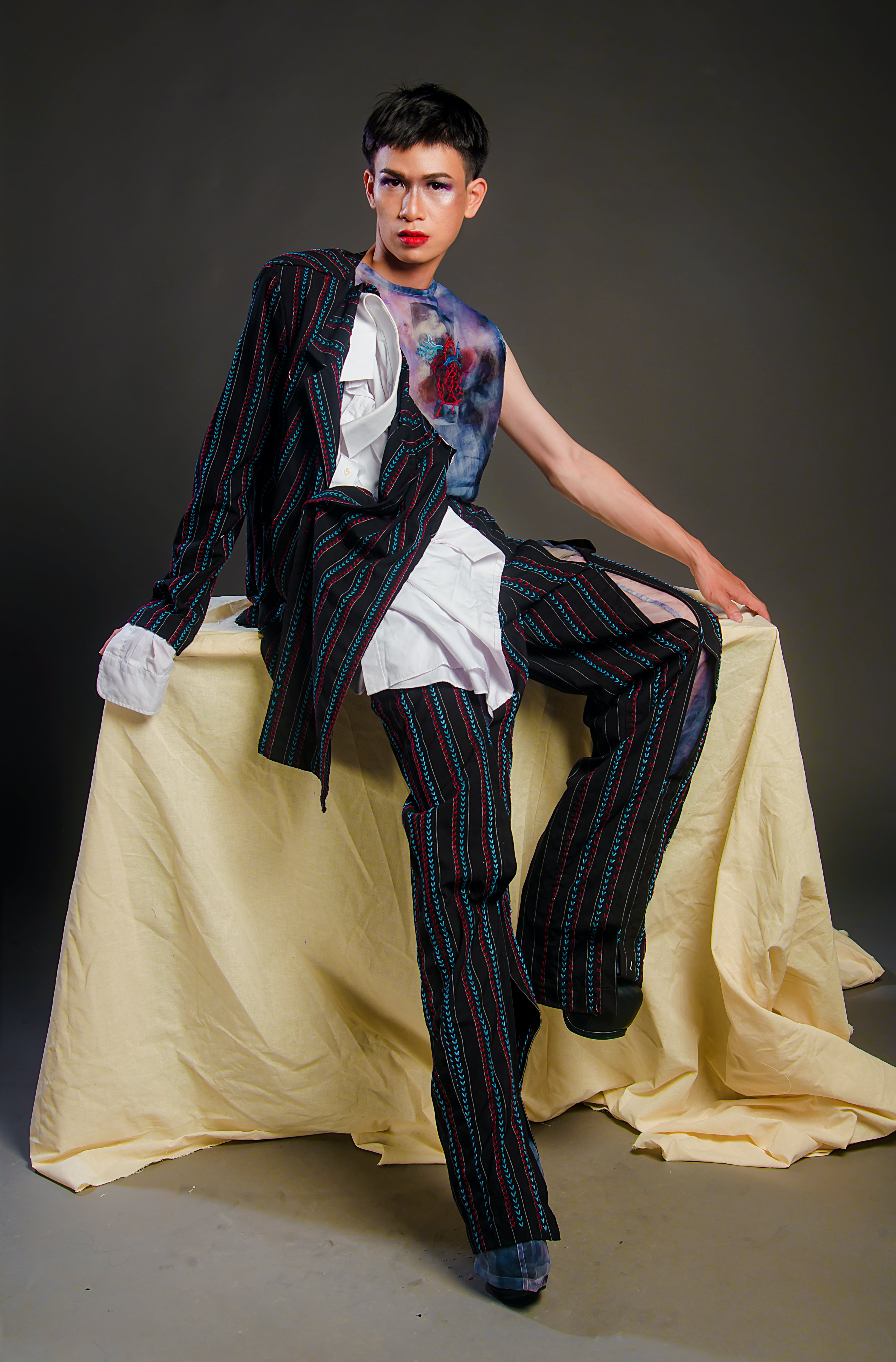Photography Of Man Wearing Multi-colored Pinstripe Outfit