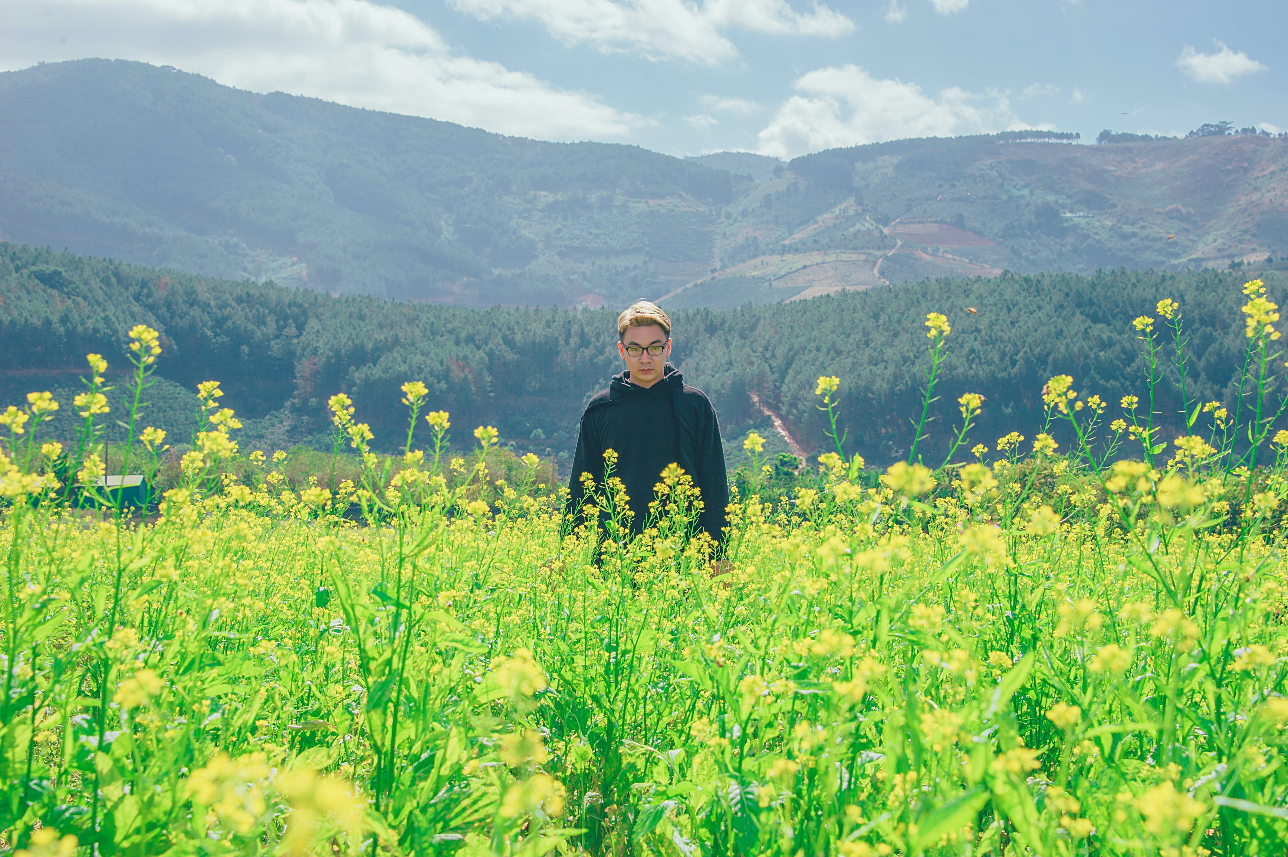 Photography of a Man Surrounded By Flowers