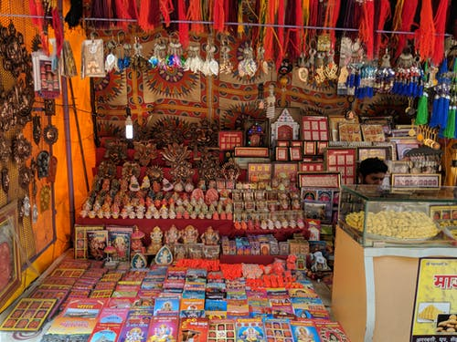Free stock photo of books, hanging, shops, street market