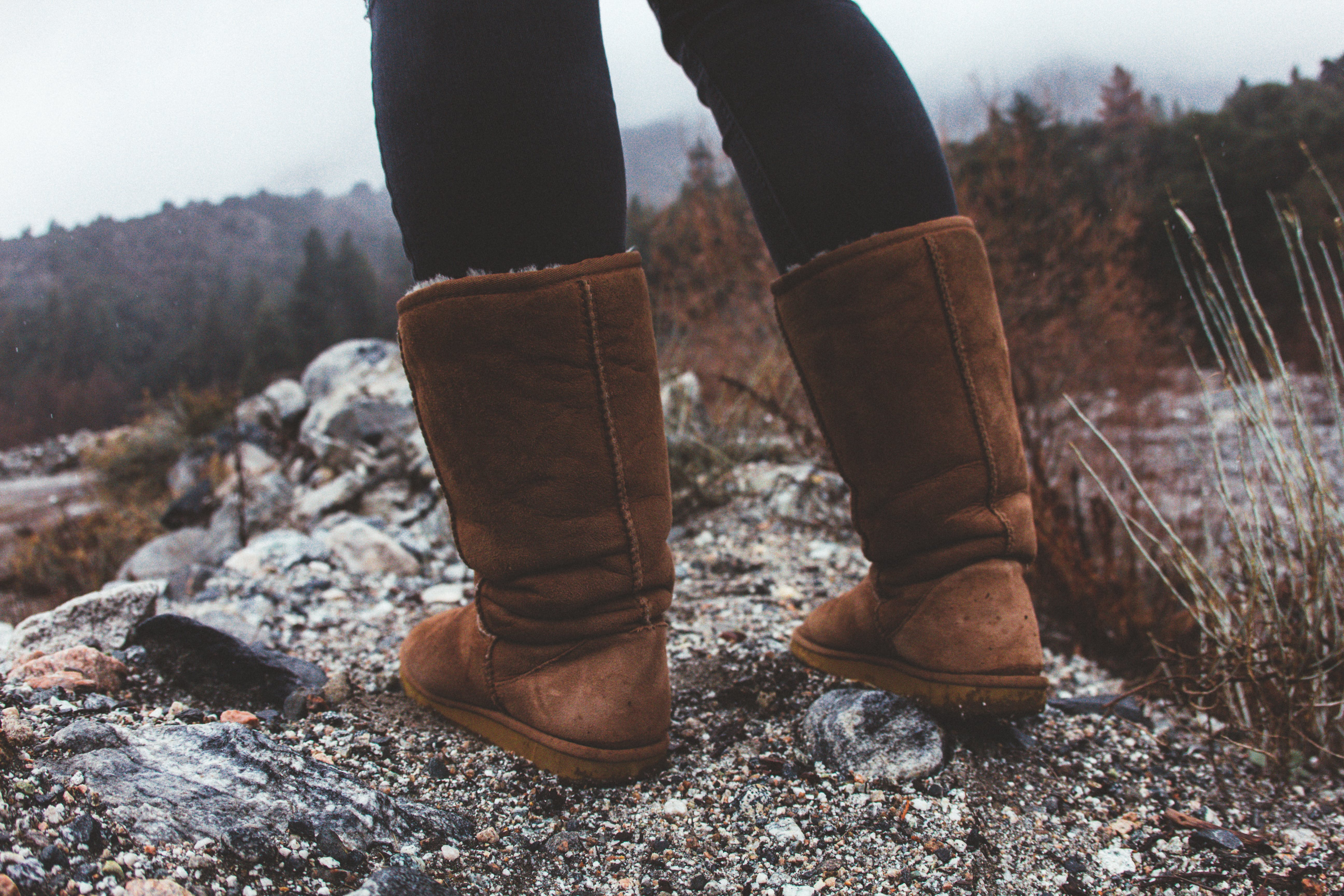 Close-Up Photography of a Person Wearing Brown Winter Boots