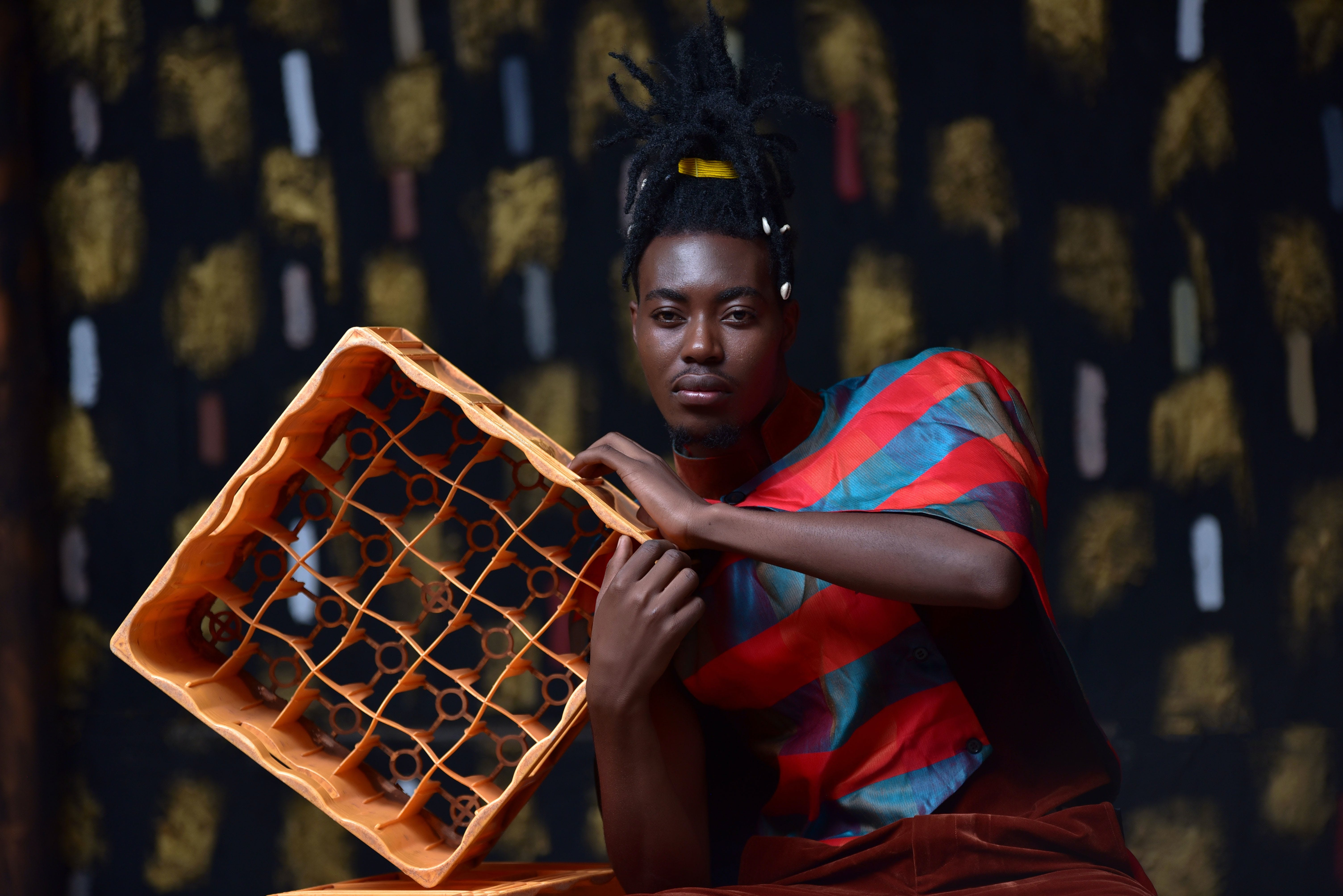 Photography of Person Holding Plastic Bottle Crate