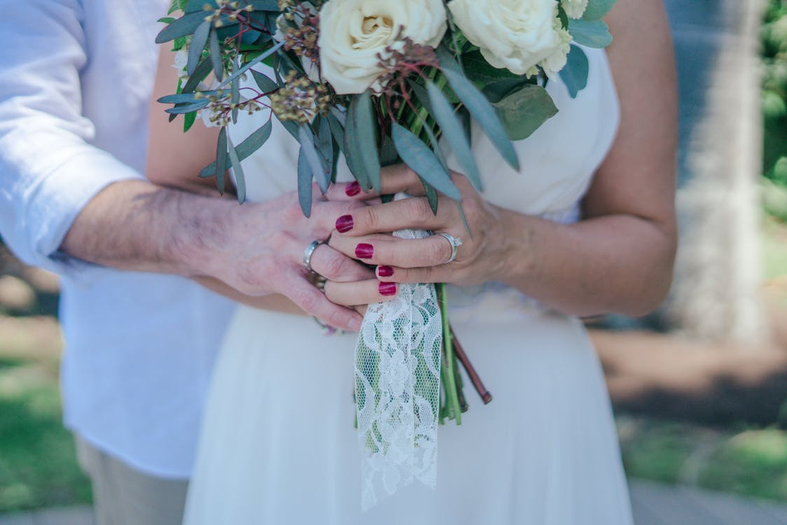 Woman Holding White Bouquet
