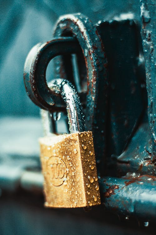 Close-Up Photography of Wet Padlock