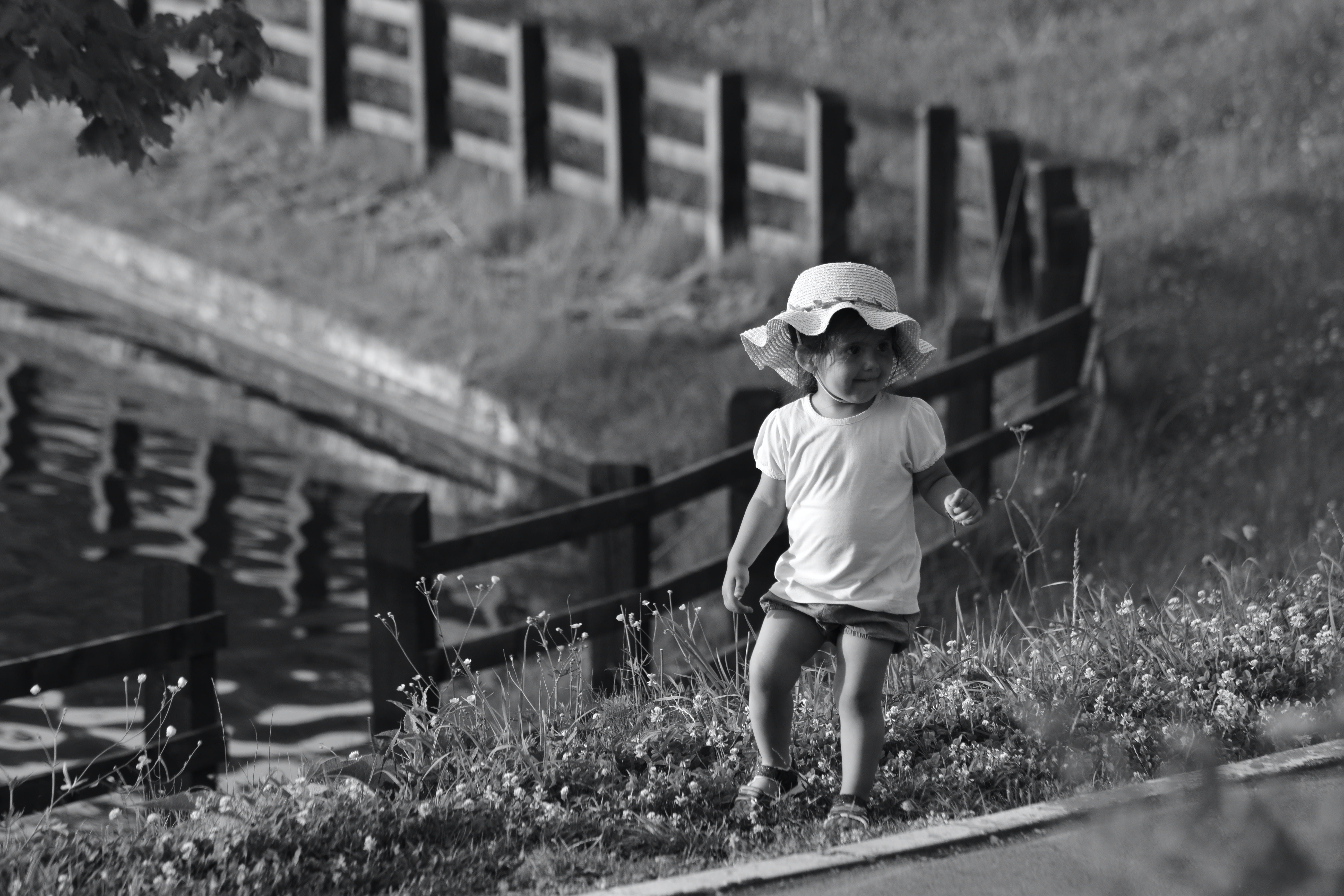 Monochrome Photography of Toddler On Flowers
