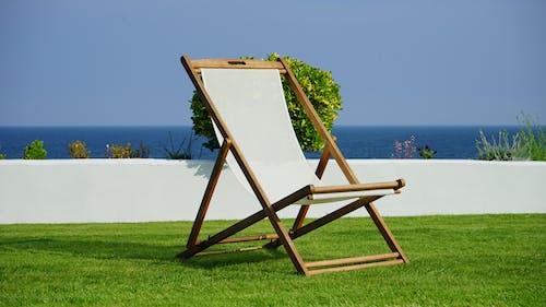 Foto profissional grátis de aconchegante, água, assento, azul
