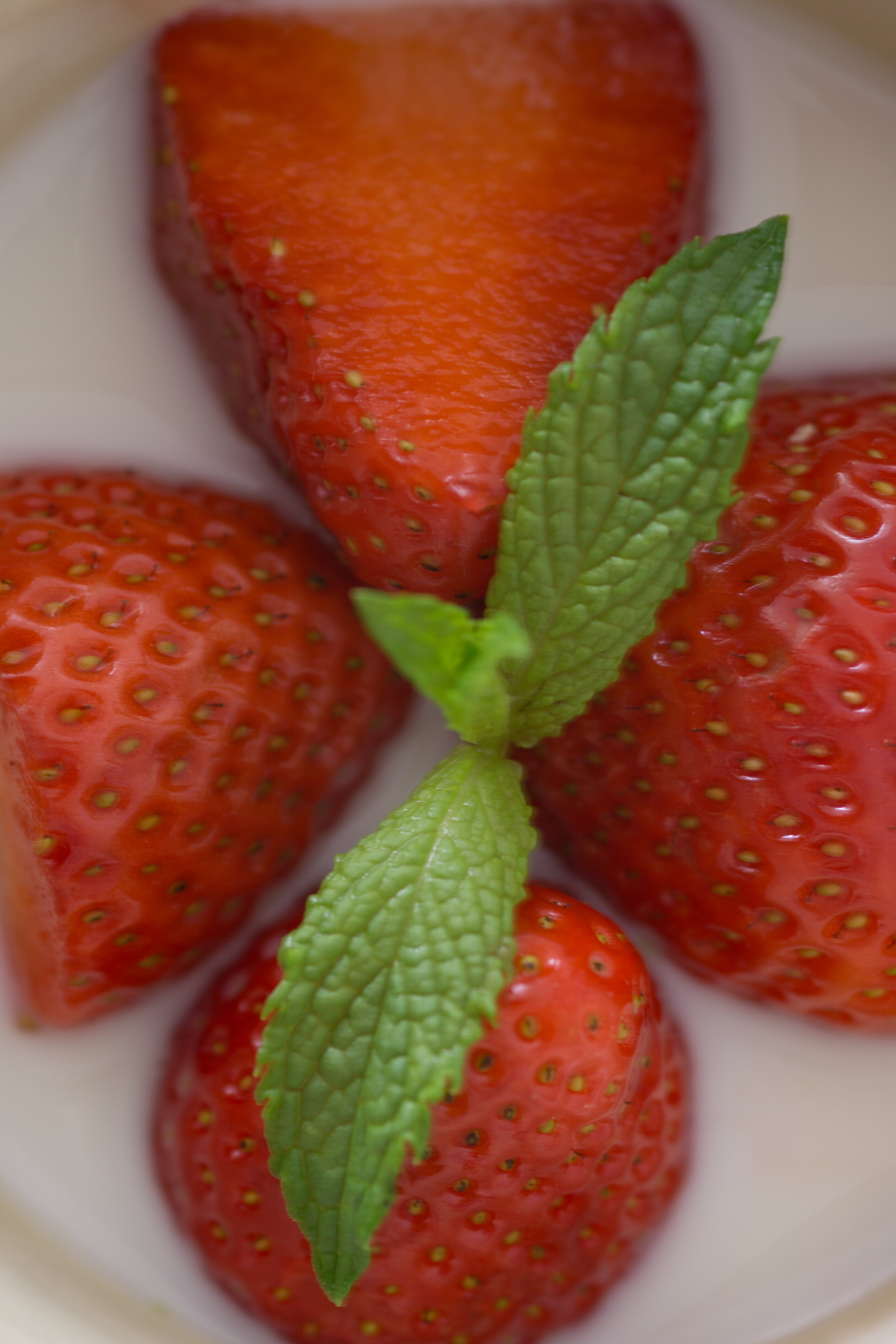 Four Strawberries on White Plate