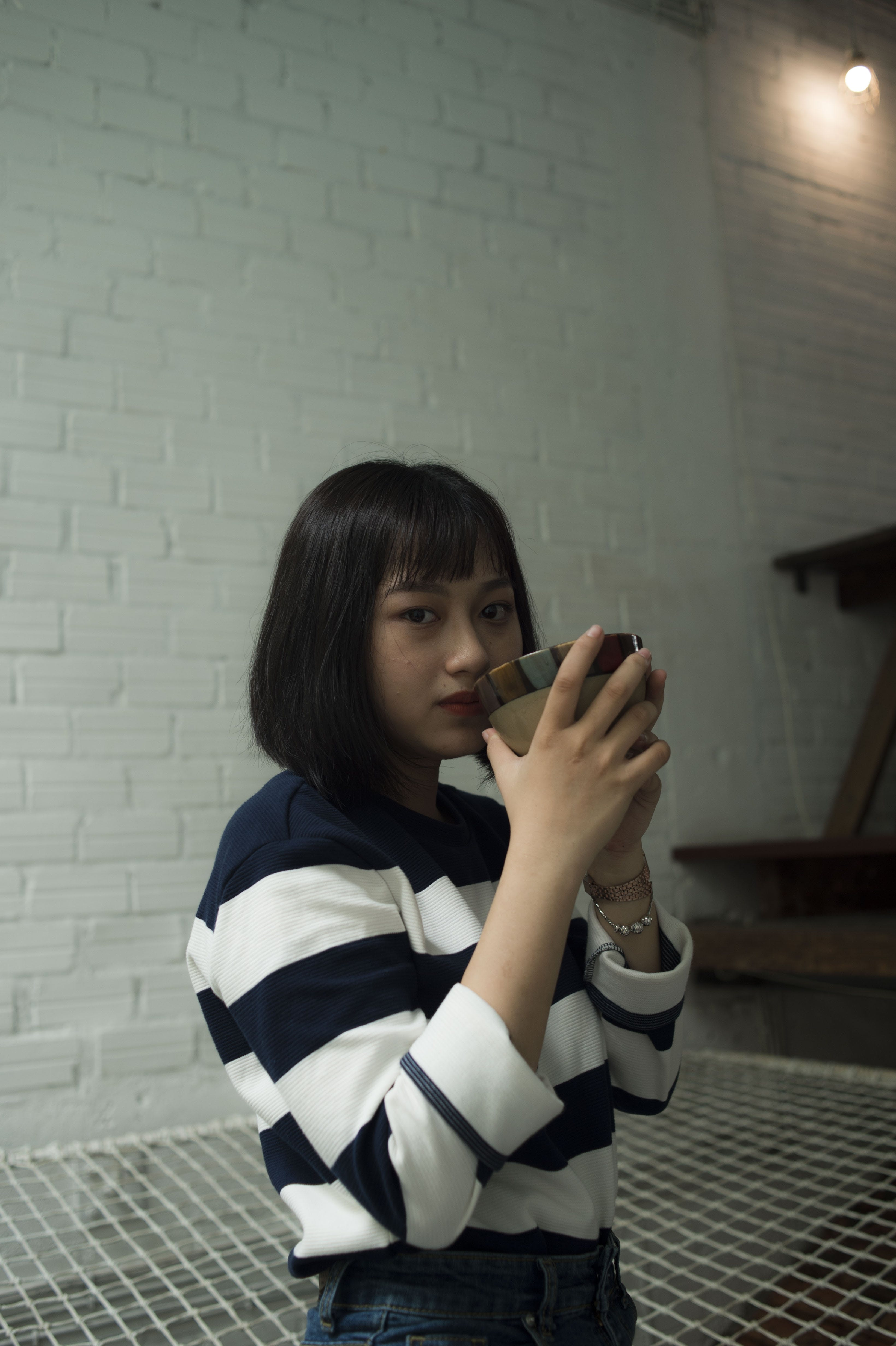 Photo of Woman Wearing Black and White Stripe Top
