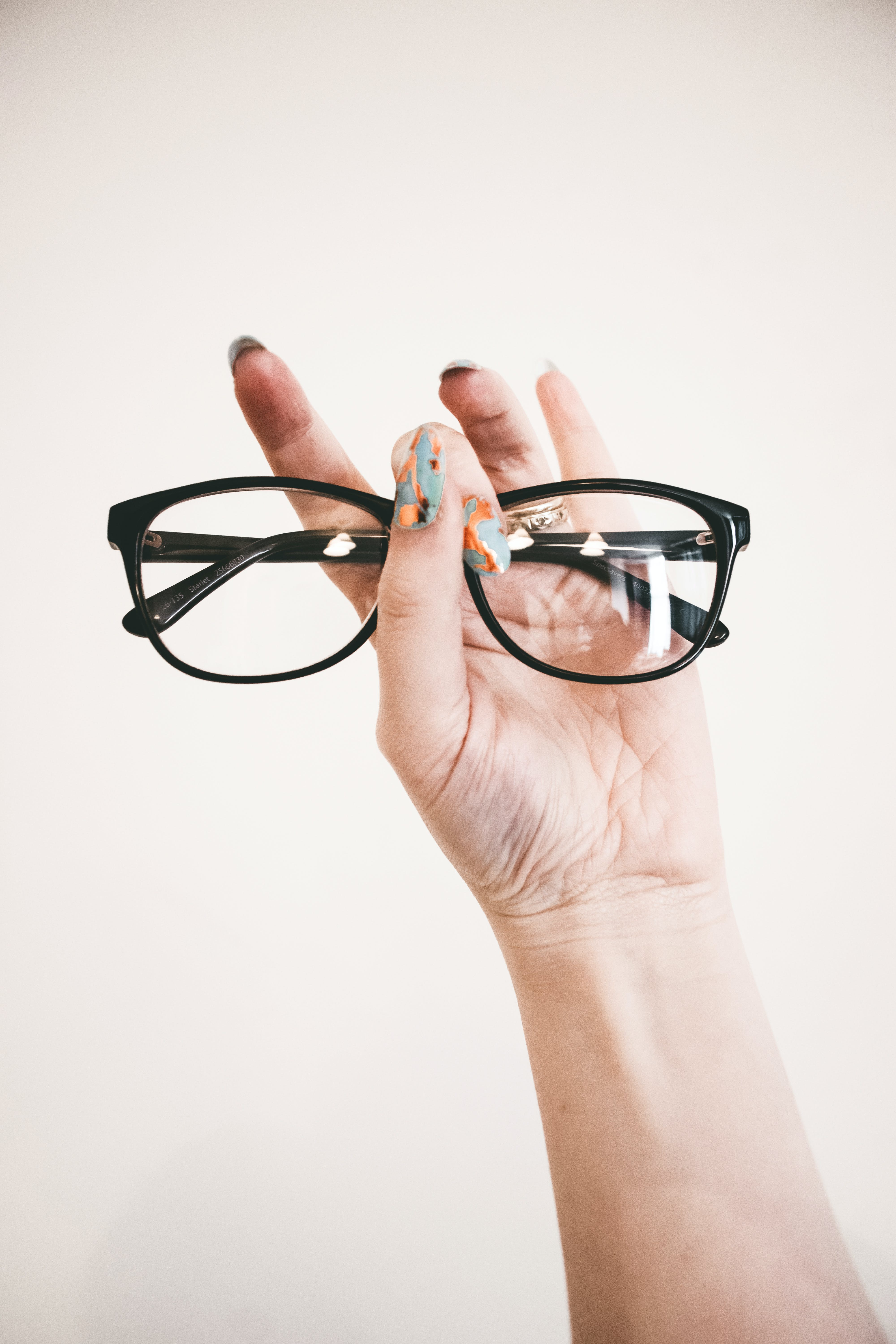 Photo of Person Holding Eyeglasses