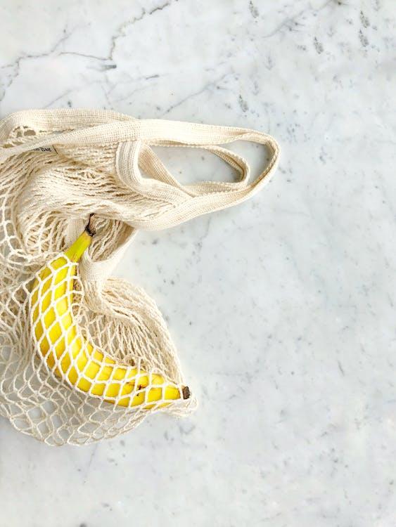 Ripe Banana in White Knitted Bag
