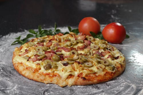 Photography of Pizza With Olive Toppings