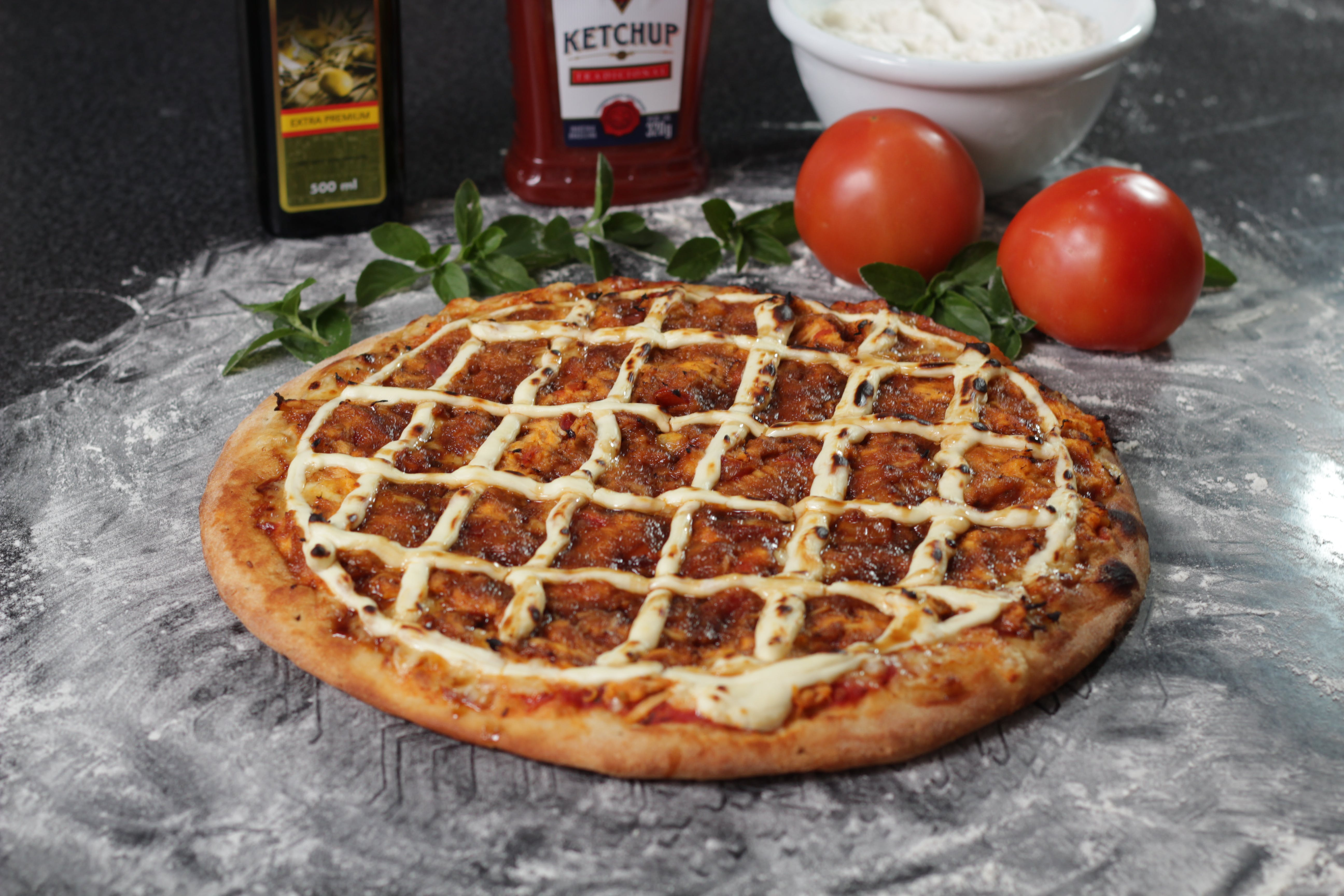 Baked Pizza Beside Two Red Tomatoes