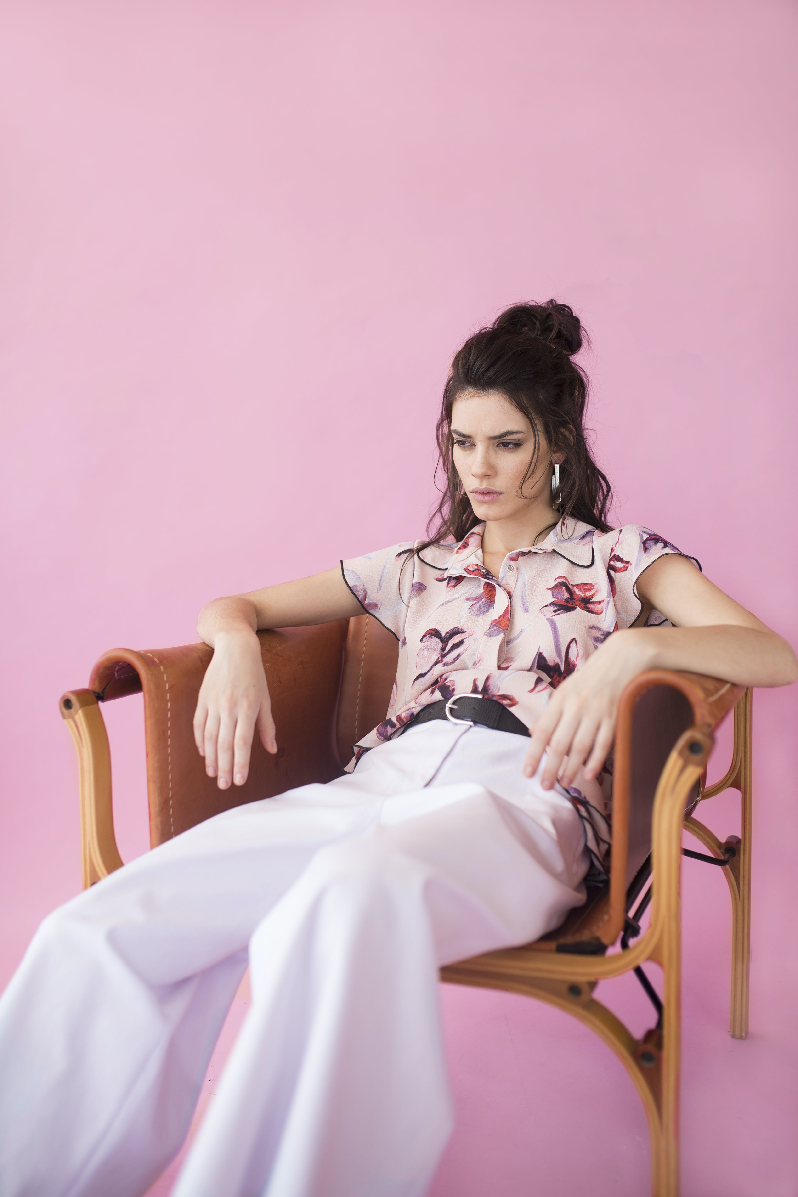 Photography of a Woman Sitting on Chair