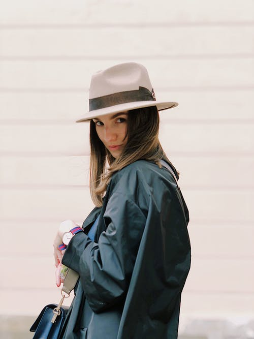 Photography of a Woman Wearing Fedora