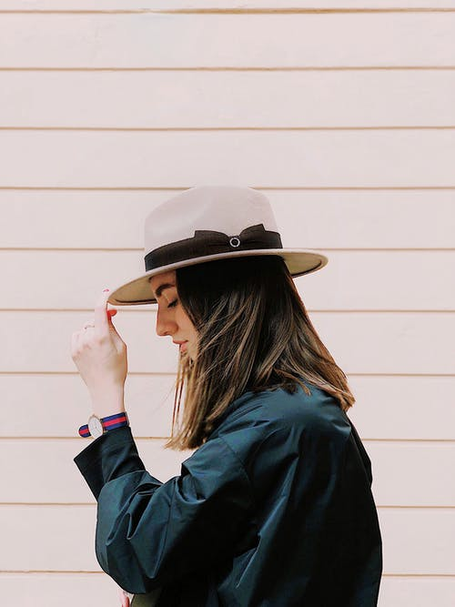 Side View Photography of a Woman Wearing Fedora