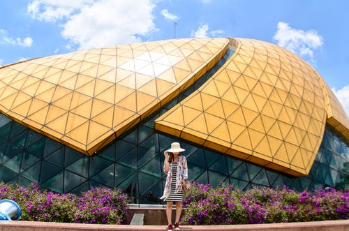 Woman Standing Near Dome Building