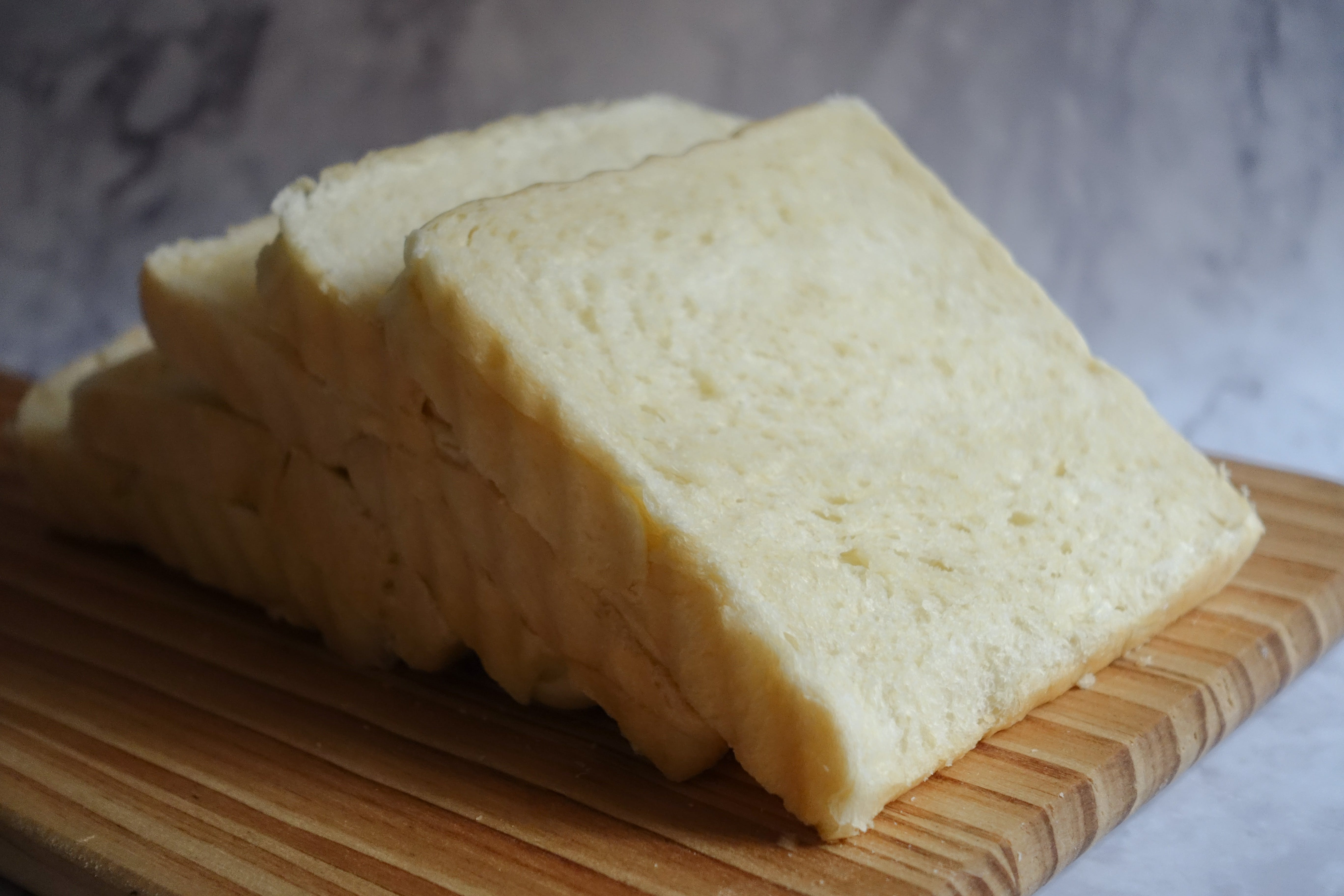 Photo of  Sliced Bread on Brown Wooden Chopping Board