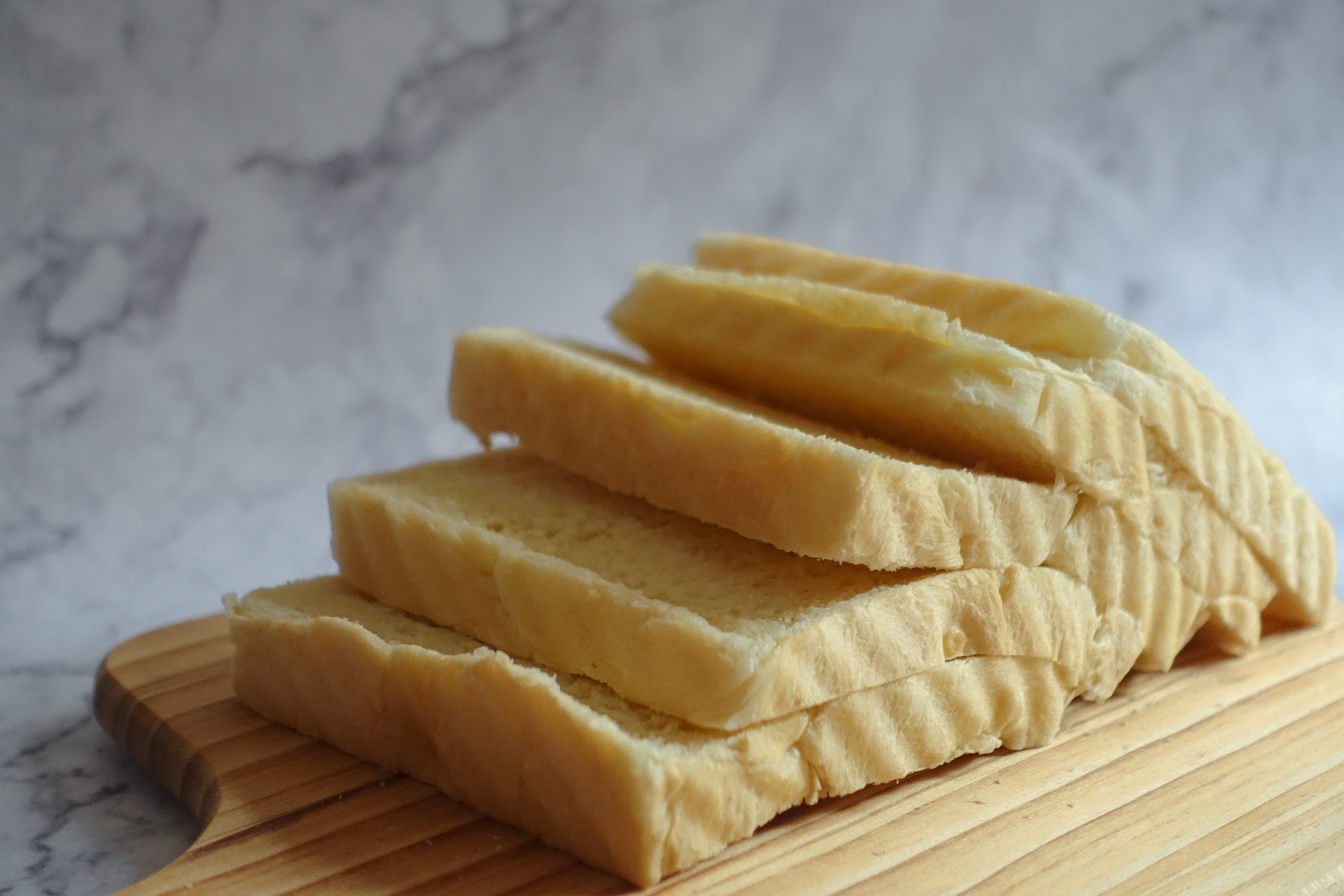 Sliced Loaf Bread on Chopping Boar