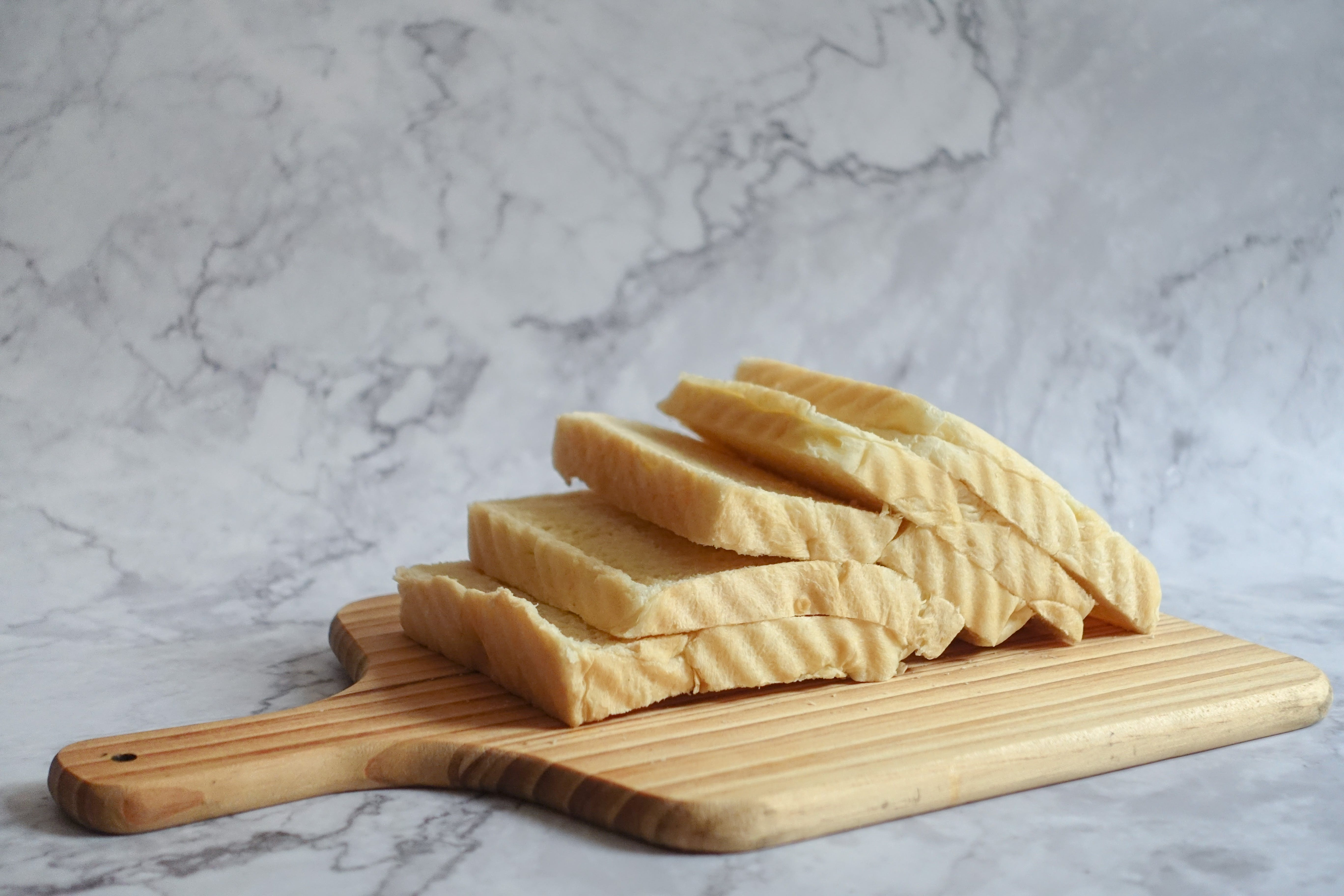 Slice Bread on Brown Chopping Board