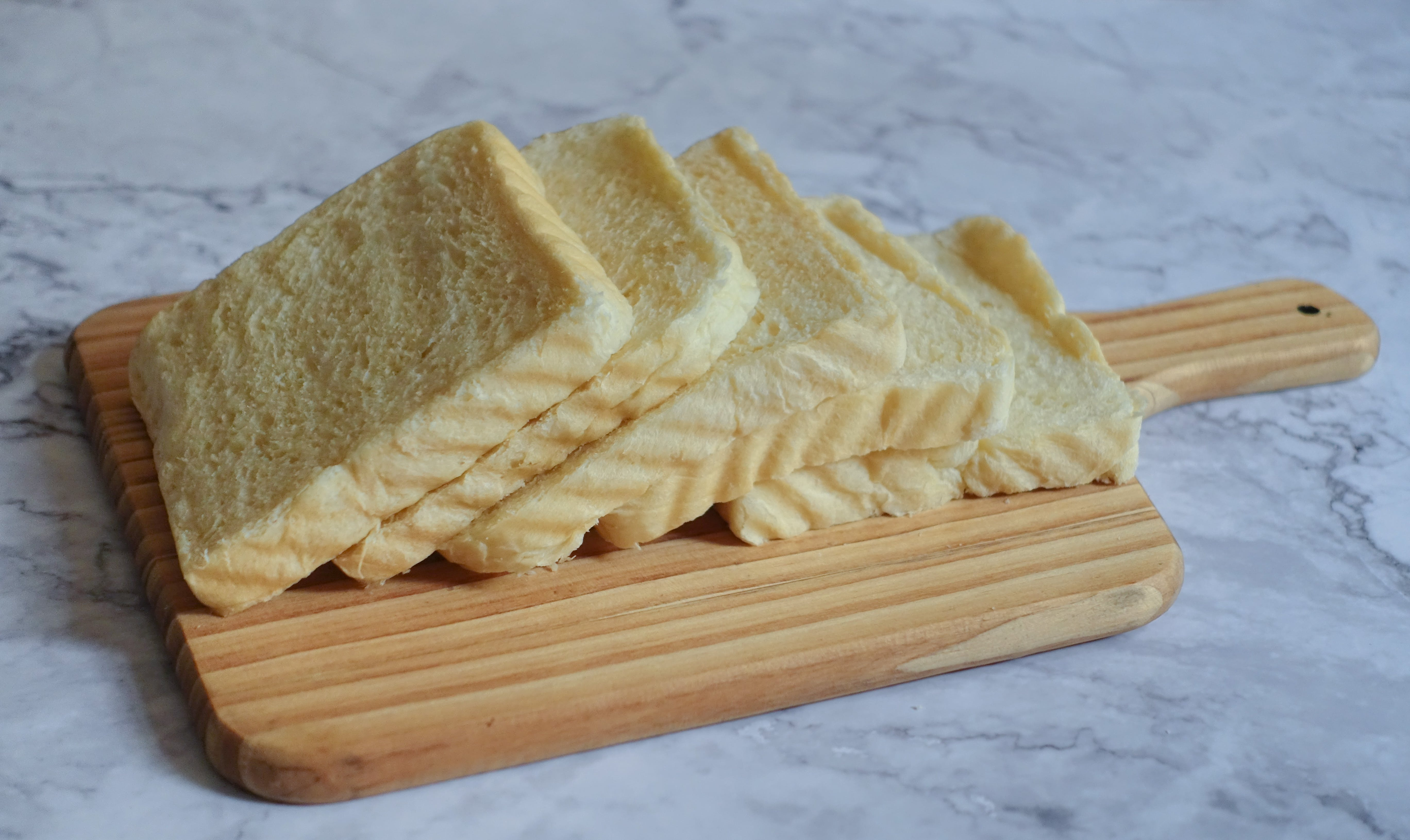 Photography of Sliced Bread on Chopping Board