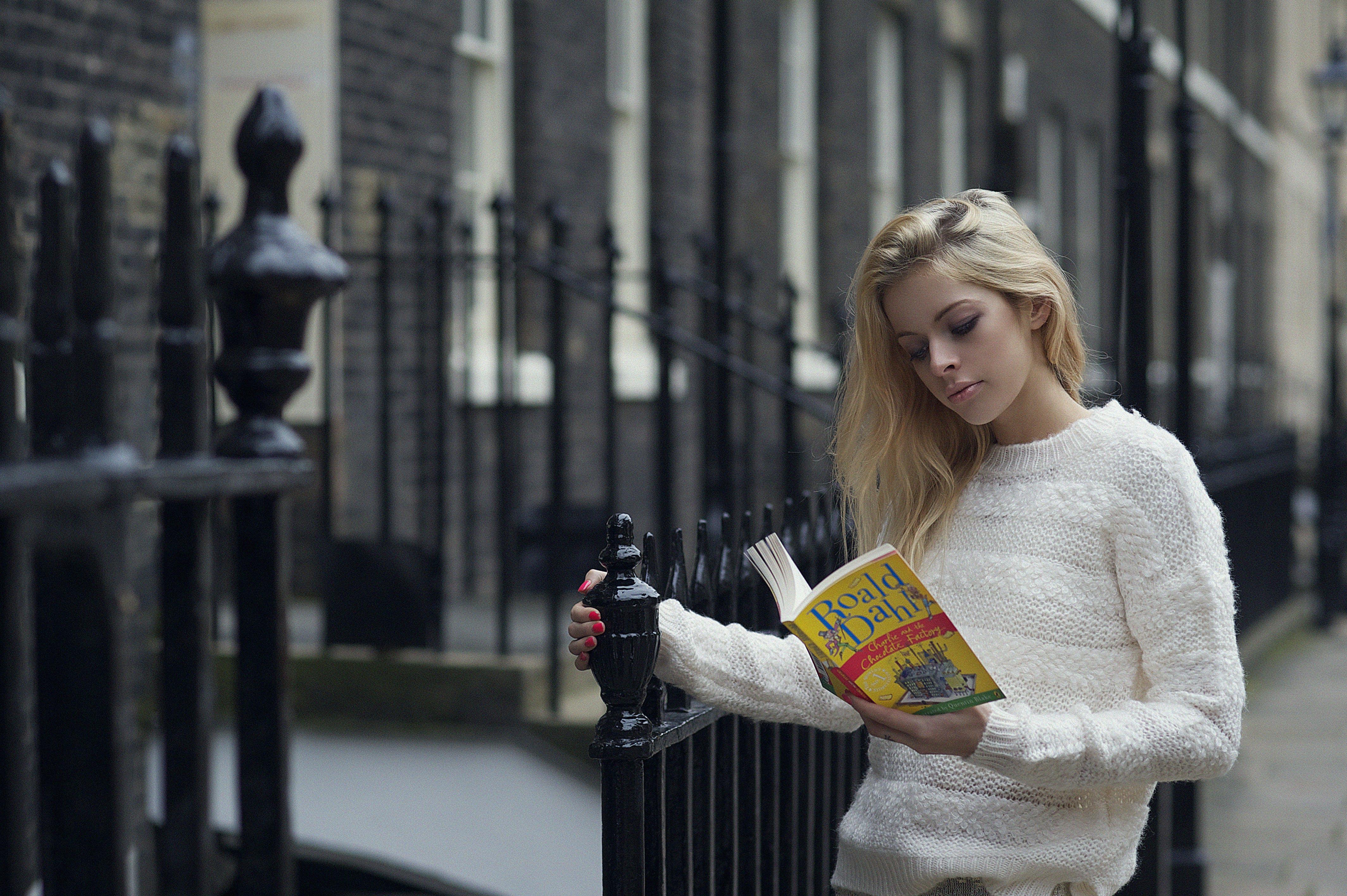 Woman Reading Boald Dahla Book