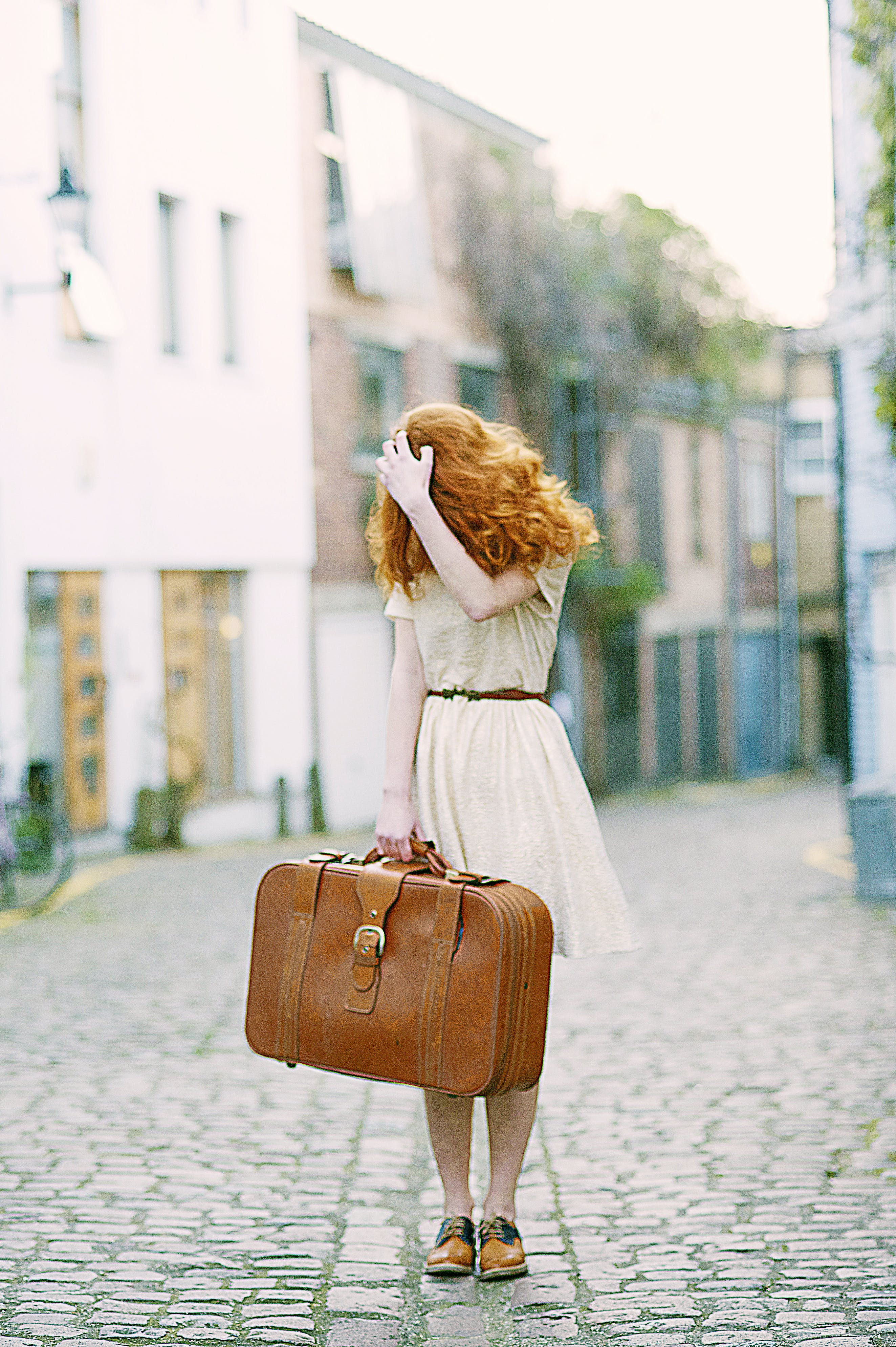 Woman In White Short-sleeved Dress Holding Brown Leather Suitcase