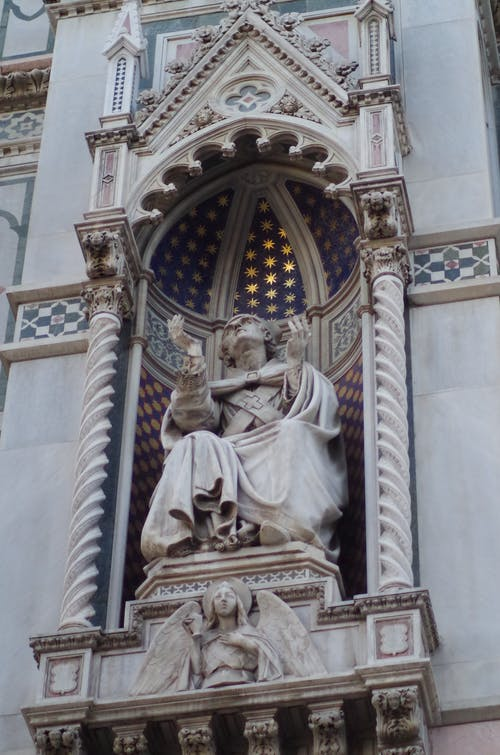 Ornate Statue of Person in Robes