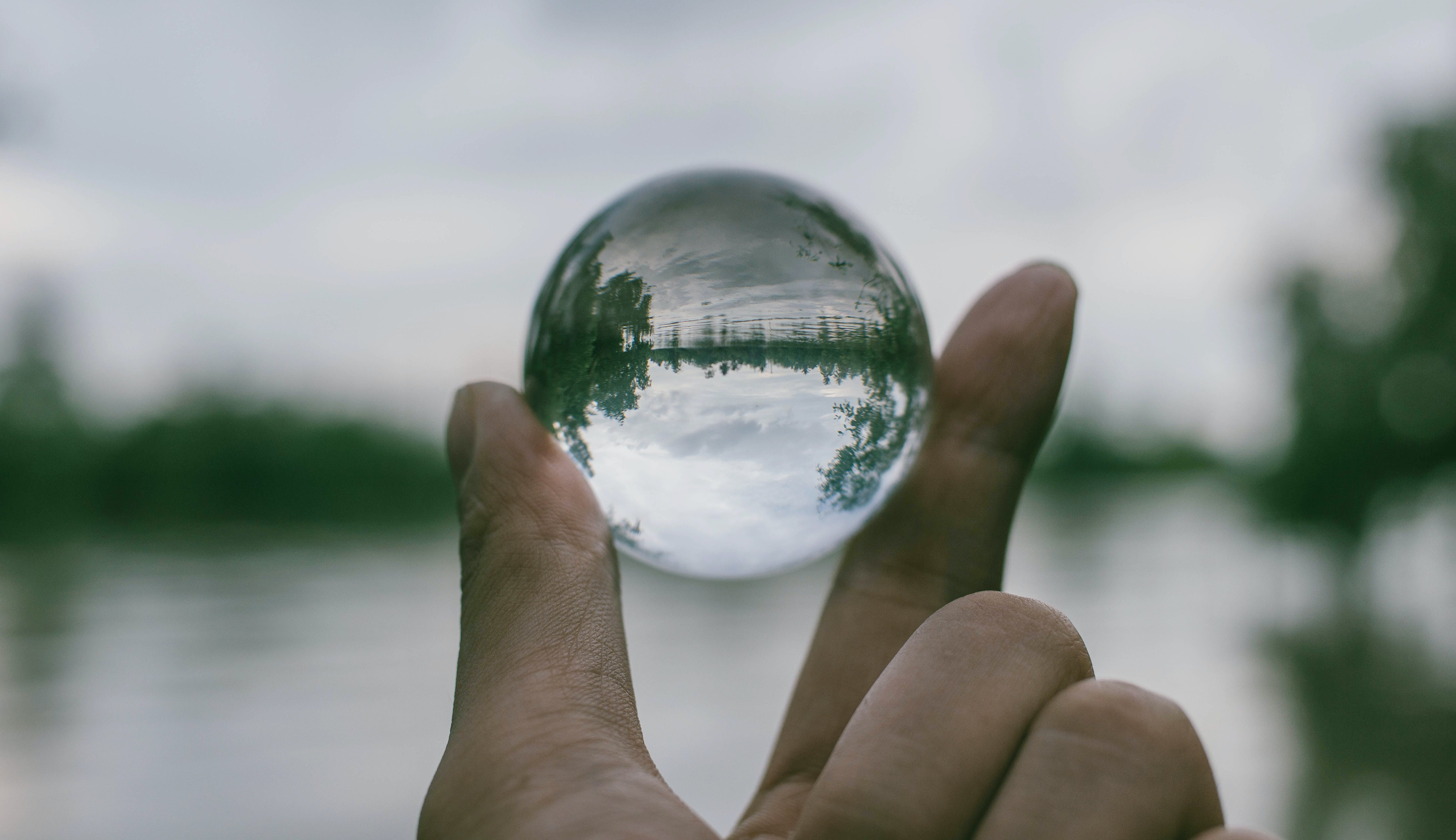 Close-Up Photography of Person Holding Crystal Ball