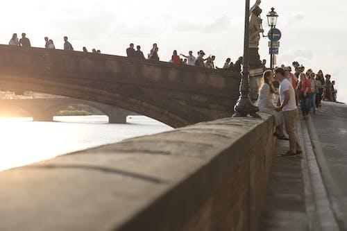 Free stock photo of golden sunset couple love florence bridge firenze, italy