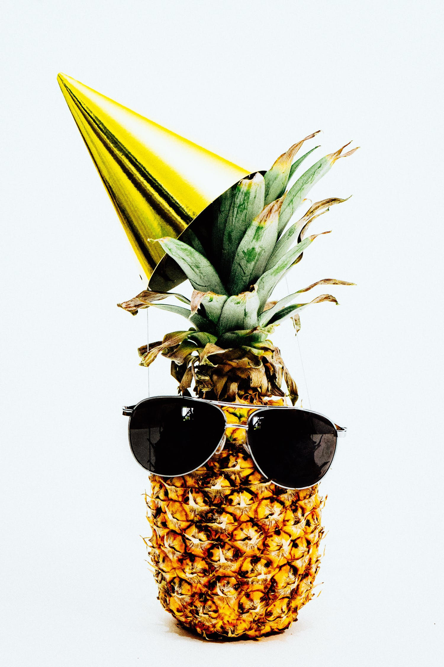 Photo Of Pineapple Wearing Black Aviator Style Sunglasses And Party Hat
