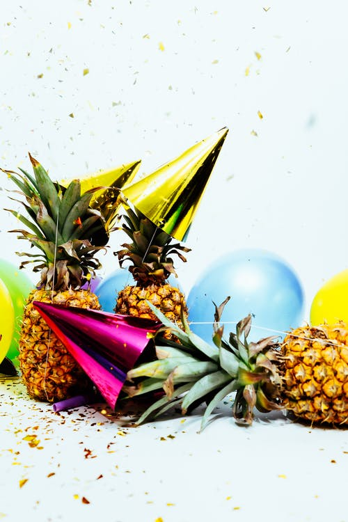 Three Pineapples With Gold Party Hats